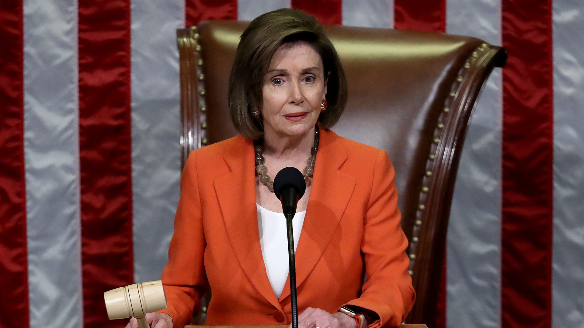 Nancy Pelosi holds the gavel at the House.