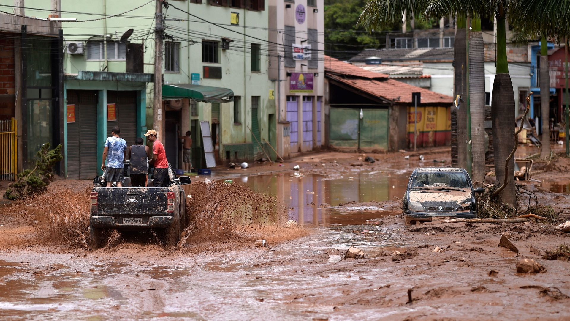 A truck rides along a flooded street after the overflowing of the Das Velhas River in Sabara