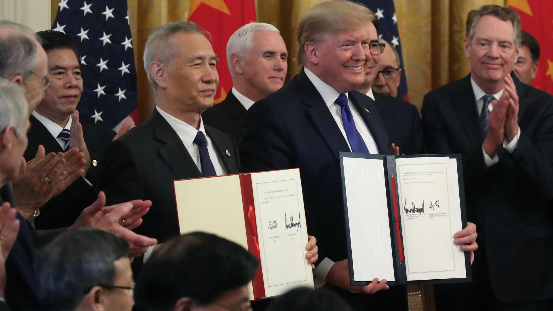 A photo of President Trump and Vice Premier Liu He holding signed copies of the U.S.-China trade deal.