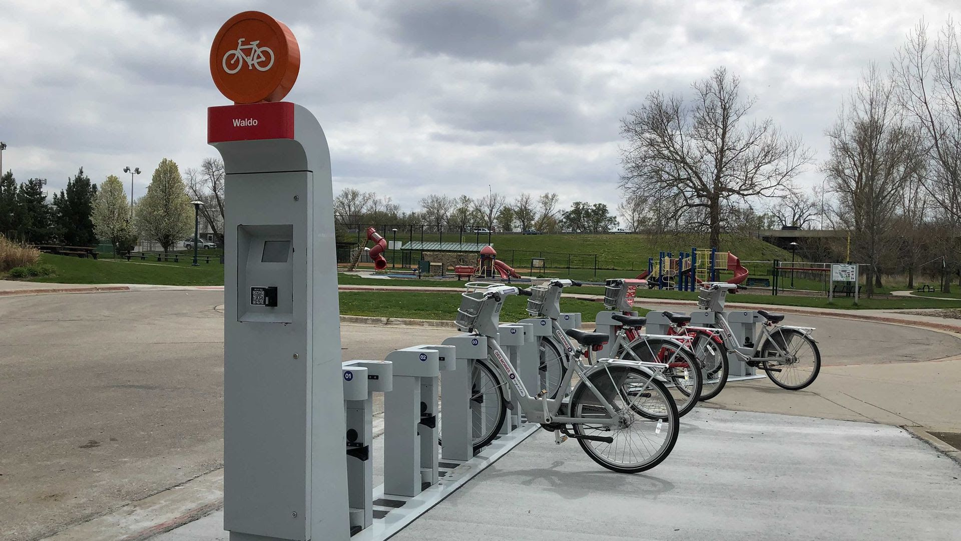 Two electric bikes are docked at a BCycle station in the Des Moines metro area.