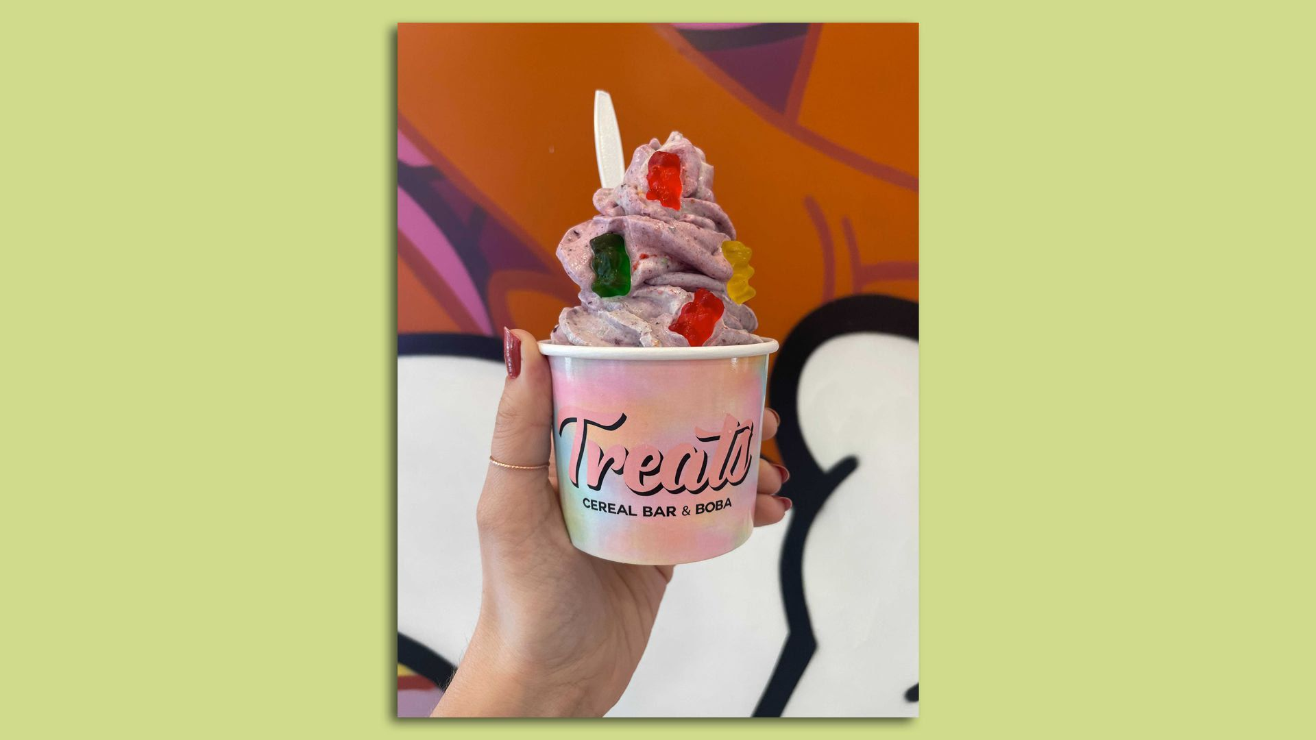 A cup of Berry Kiss ice cream topped with gummy bears from Treats Cereal Bar in St. Paul.