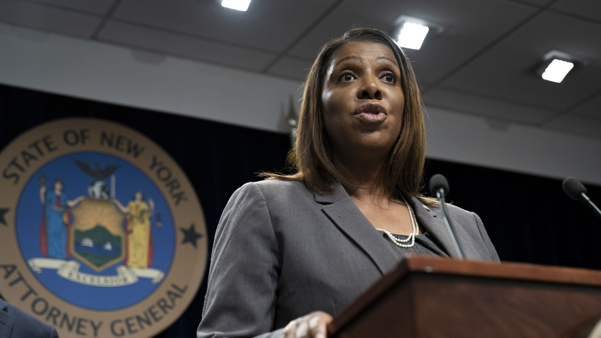 New York Attorney General Letitia James speaks at a podium