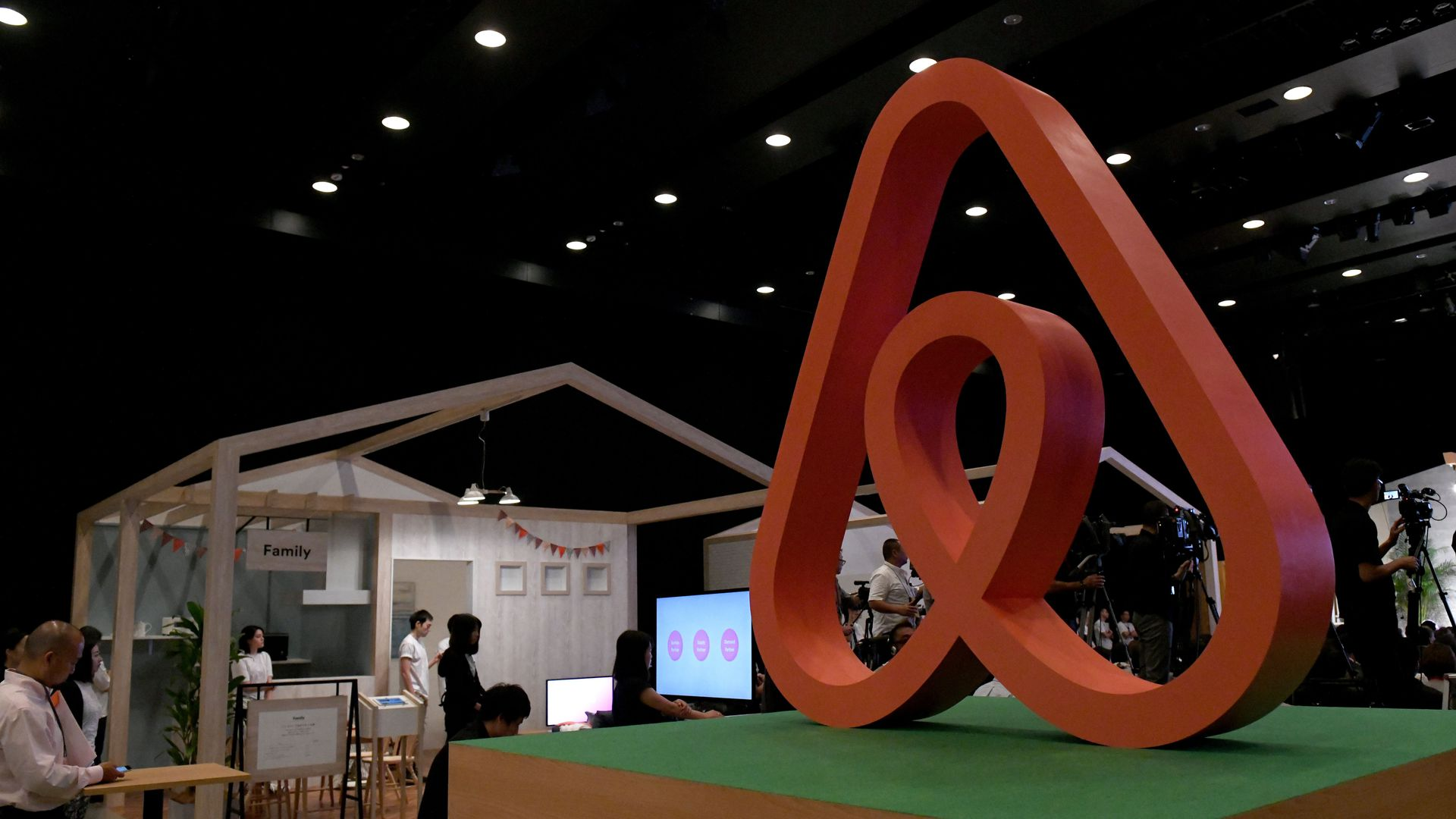 Photo of large Airbnb logo sculpture inside its Japan office.