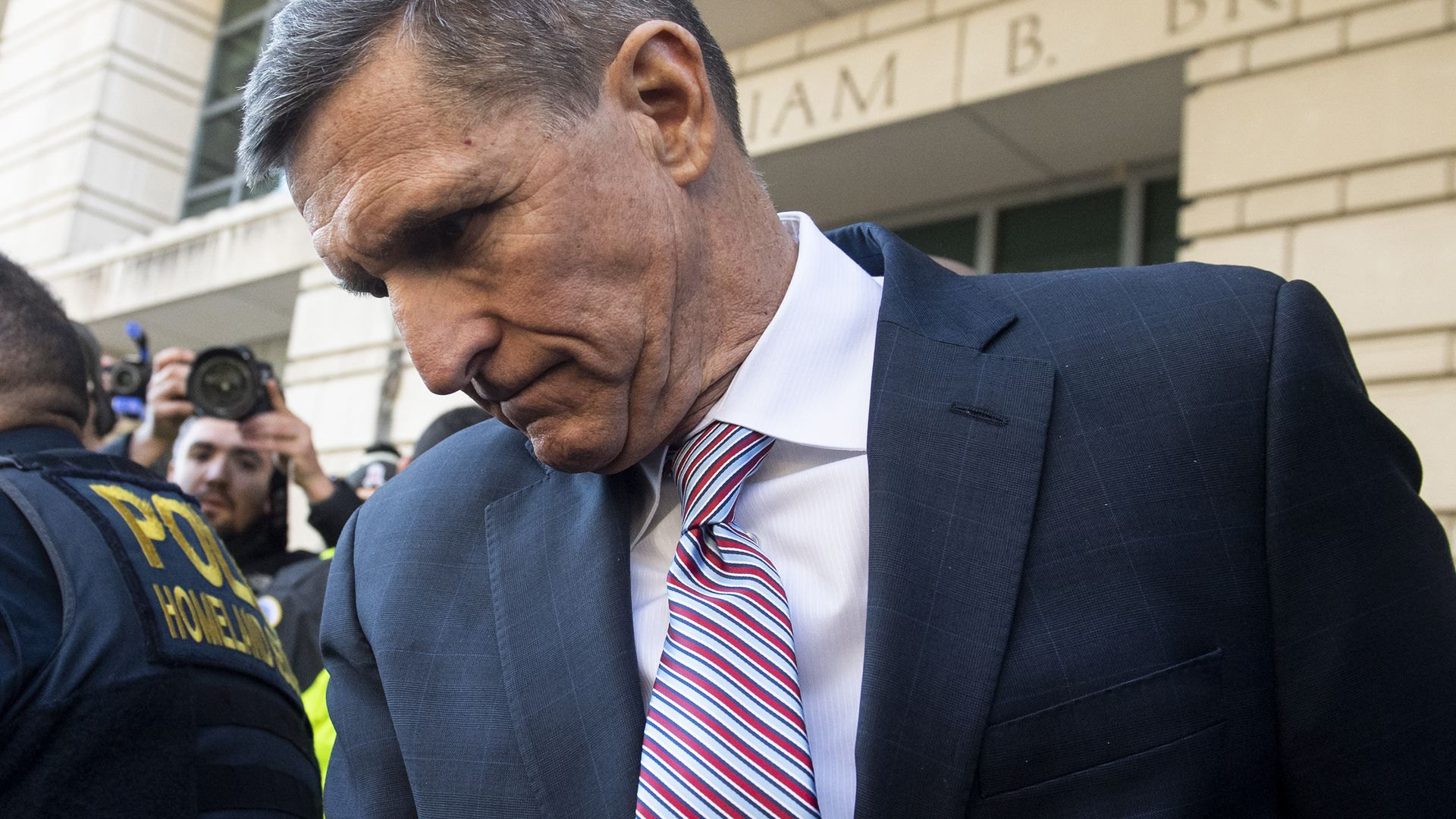 Former National Security Advisor General Michael Flynn leaves after the delay in his sentencing hearing