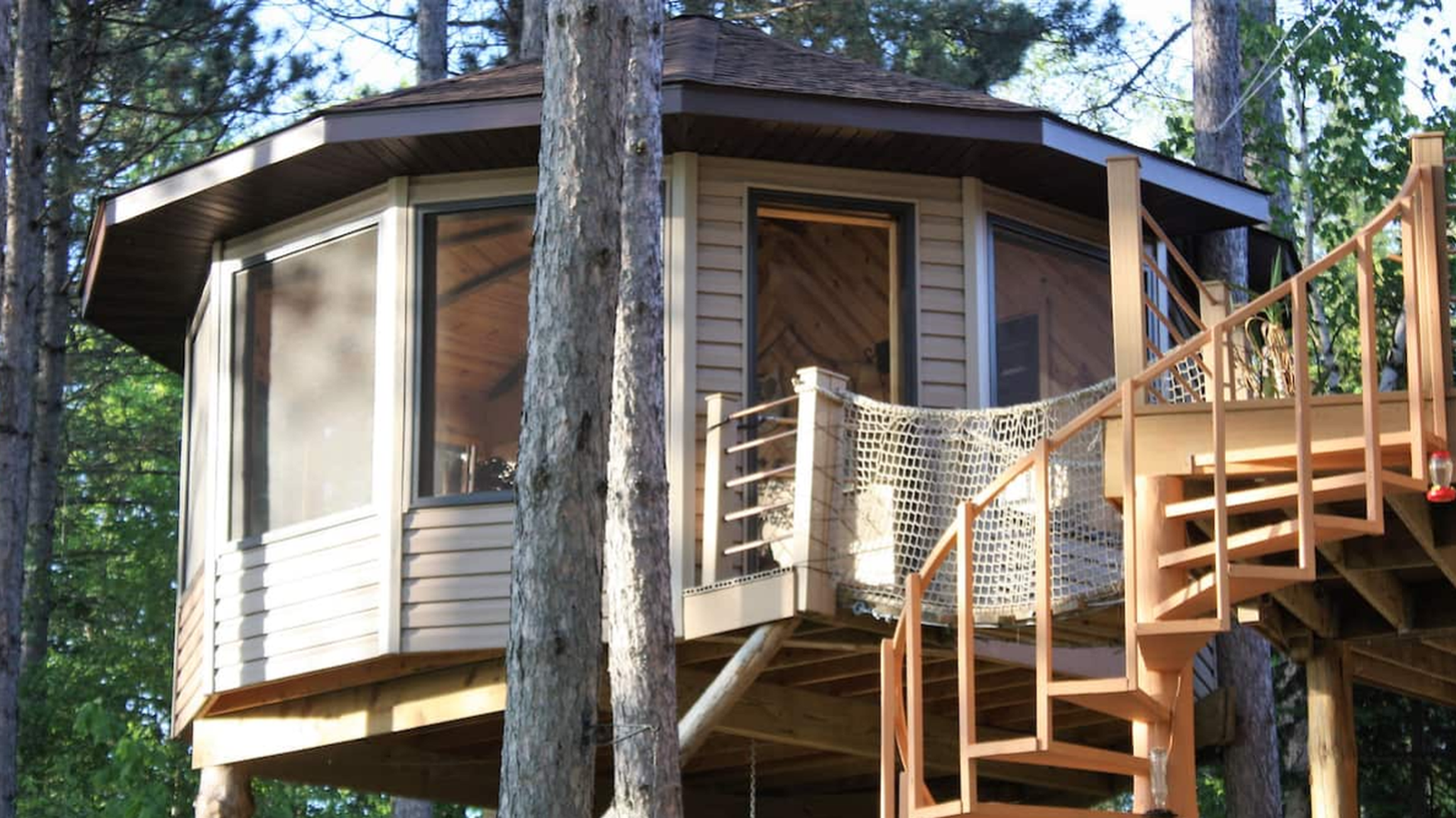 A Minnesota treehouse rental with a spiral staircase.