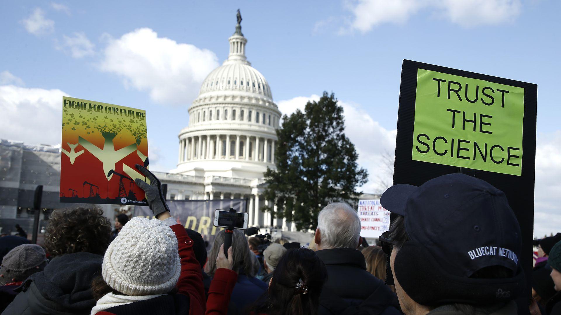Climate protestors outside Capitol Hill