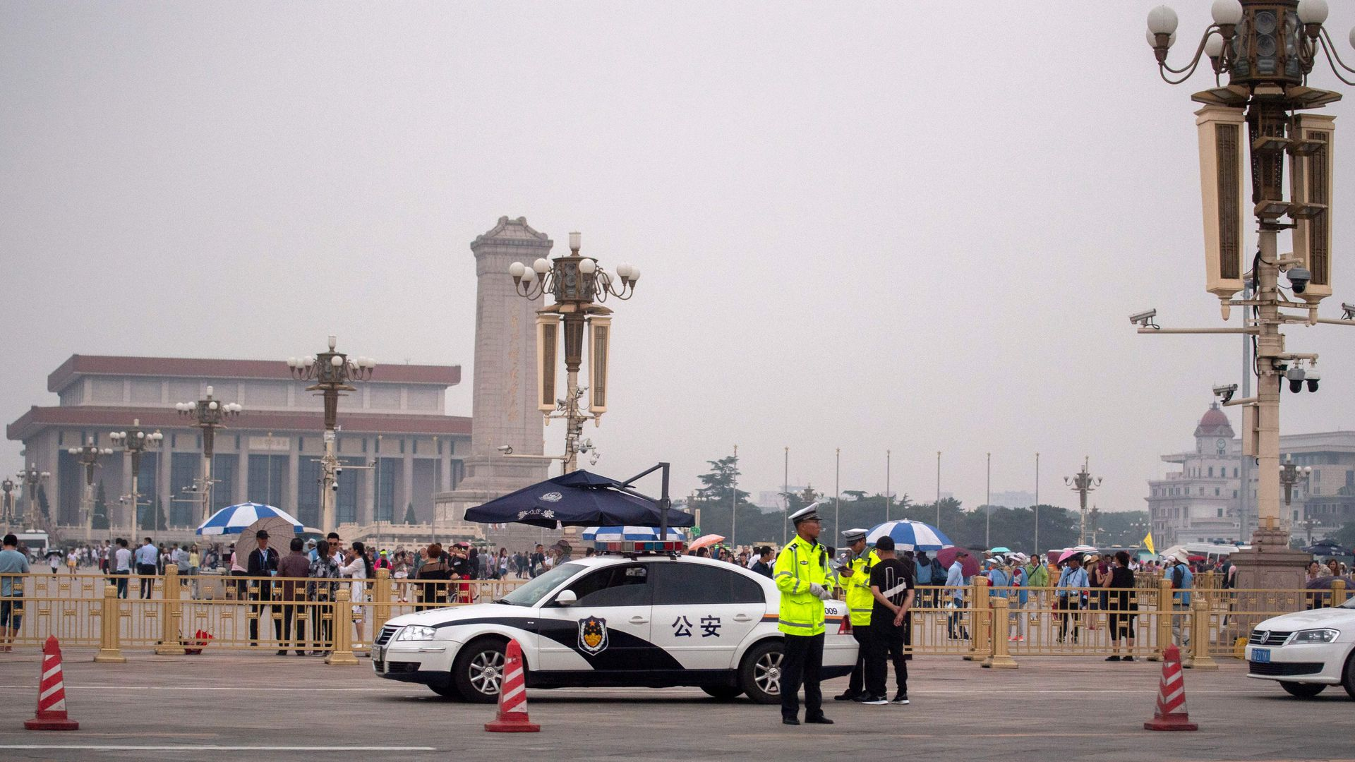 Police officers stand in front of Tiananmen Square in Beijing on June 4, 2019.