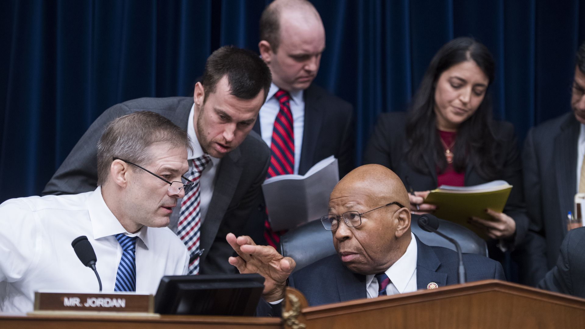 Reps. Elijah Cummings and Jim Jordan confer during a hearing