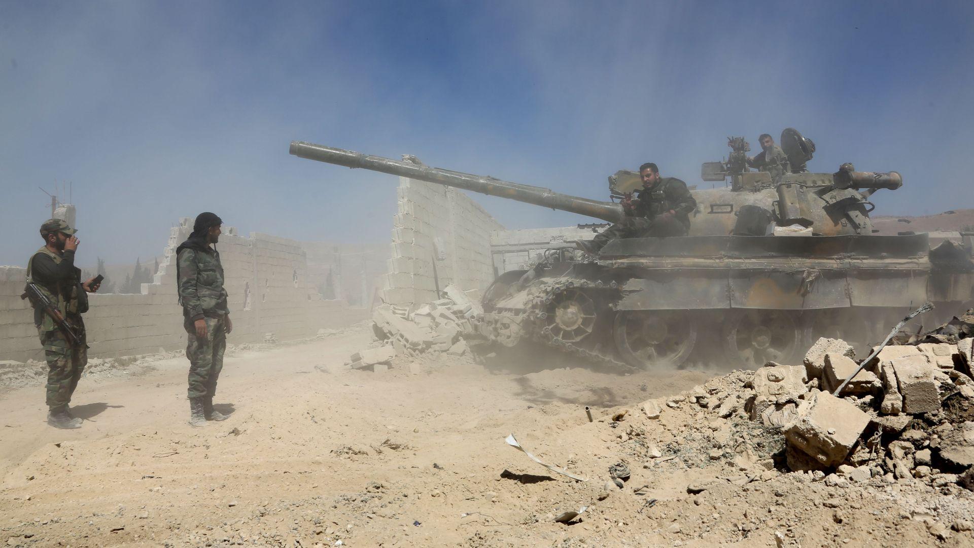 Pro-Assad forces.