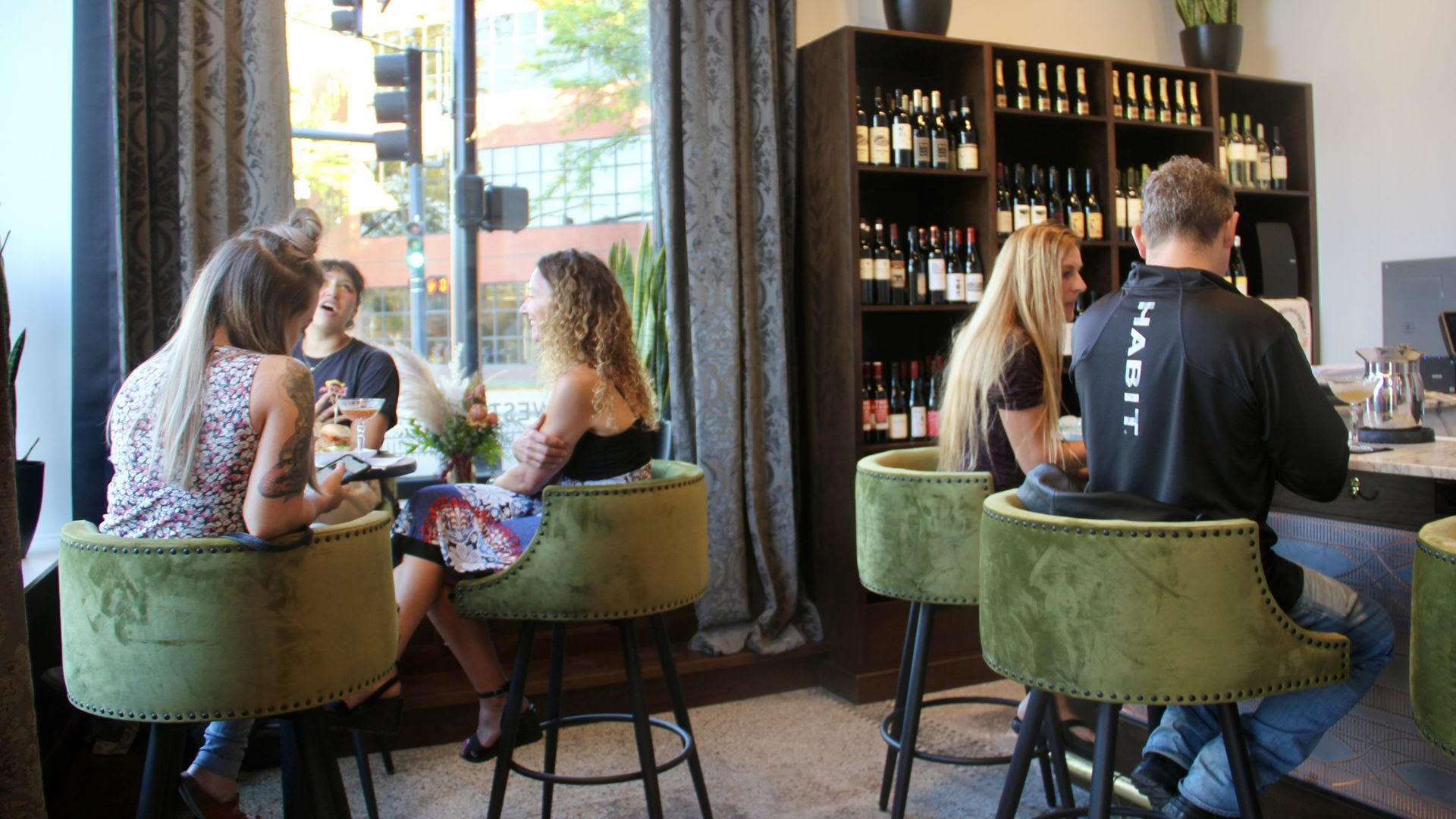 Two groups of people dine inside Des Moines' New Northwestern.