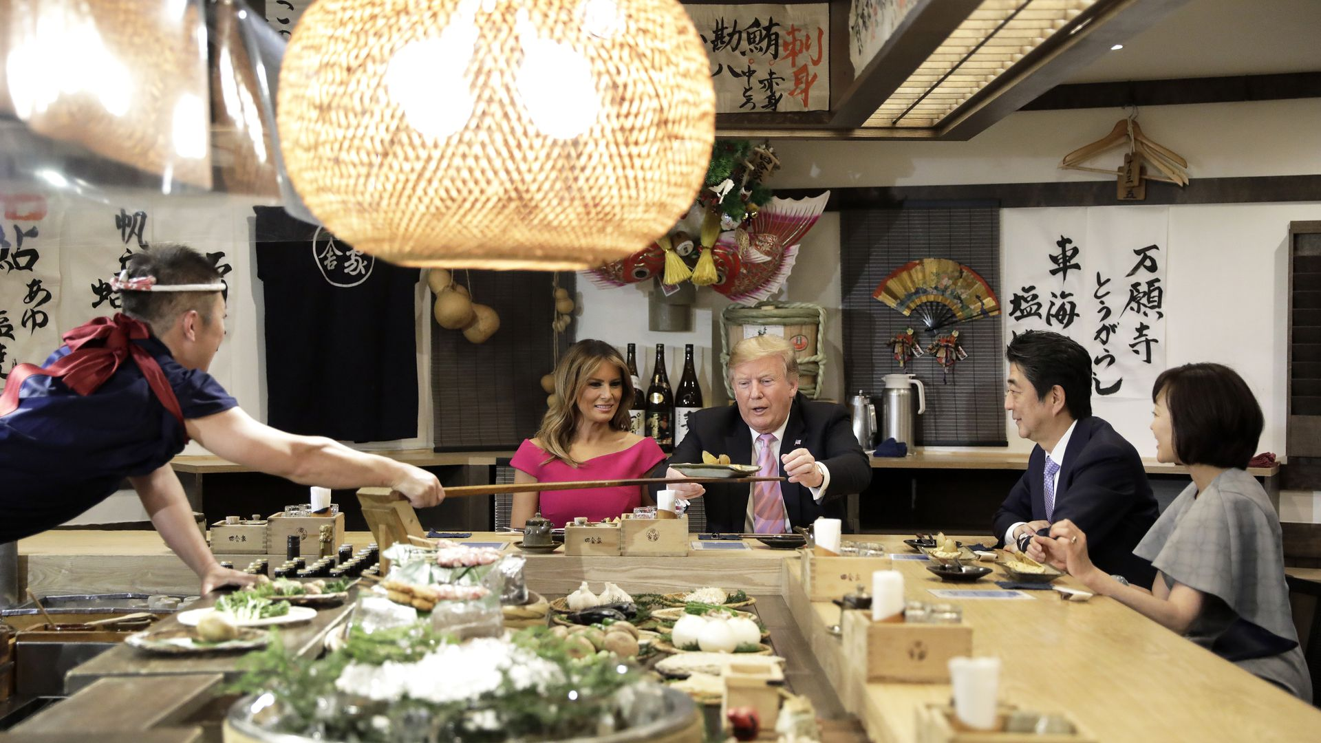 President Trump is served a baked potato with butter in Tokyo, while dining with Melania Trump, Prime Minister Shinzo Abe and his wife, Akie Abe. (Photo: Kiyoshi Ota/Pool/Getty)