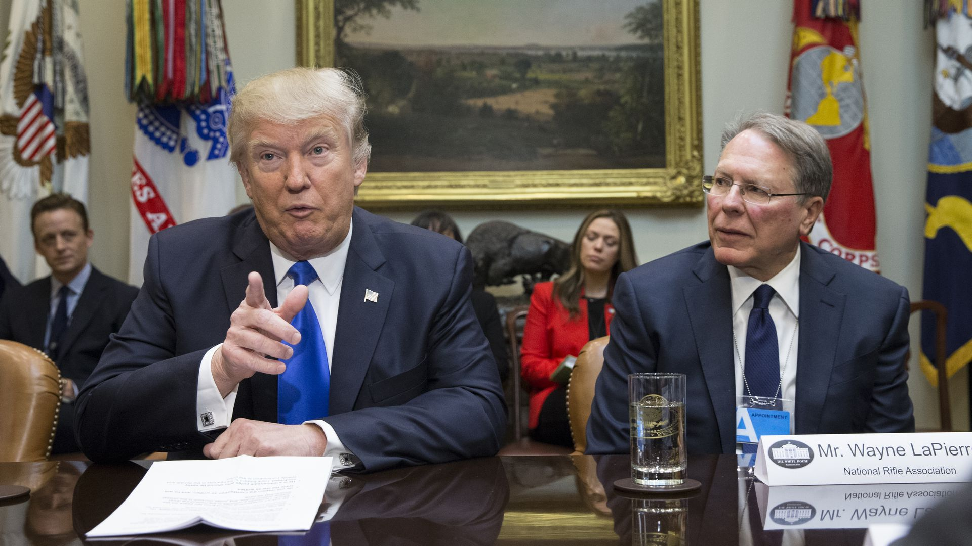 President Donald Trump (L) sits beside Executive Vice President and CEO of the National Rifle Association (NRA) Wayne LaPierre (R)in the Roosevelt Room of the White House on February 1, 2017