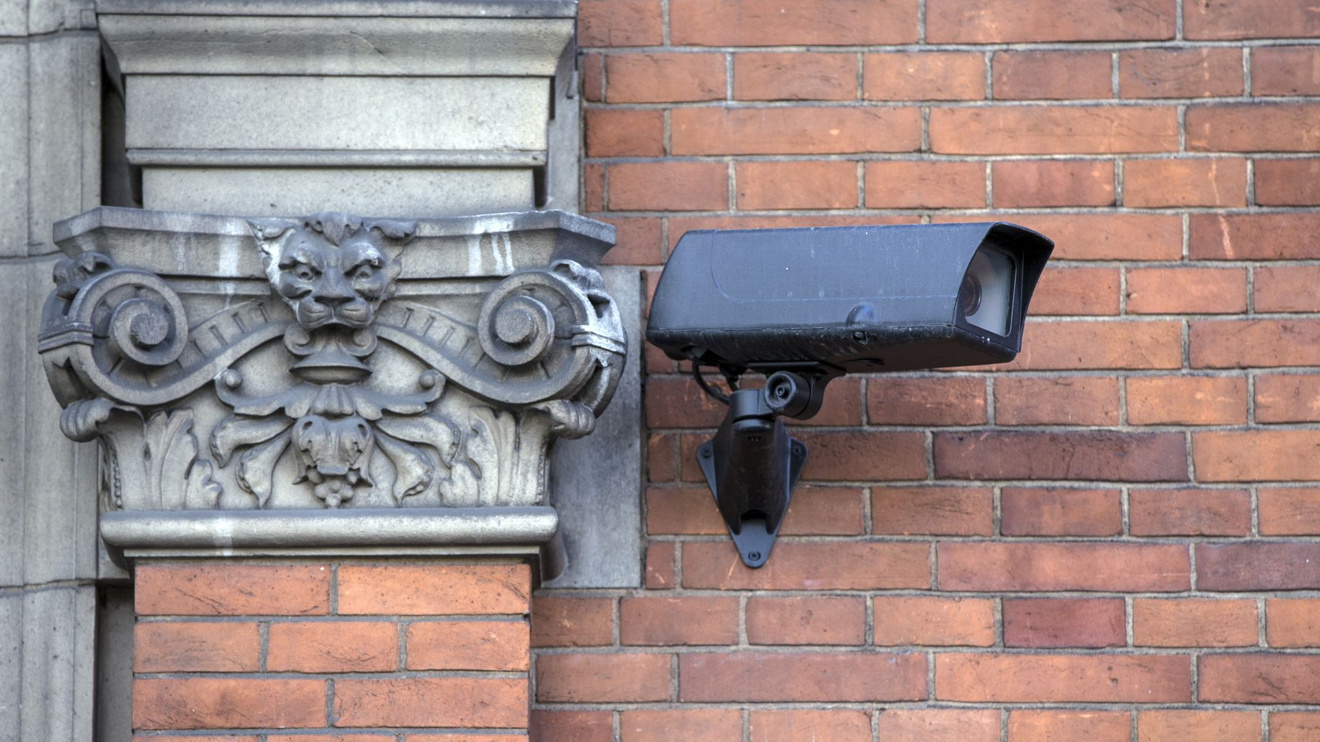 A surveillance camera is mounted on a wall.