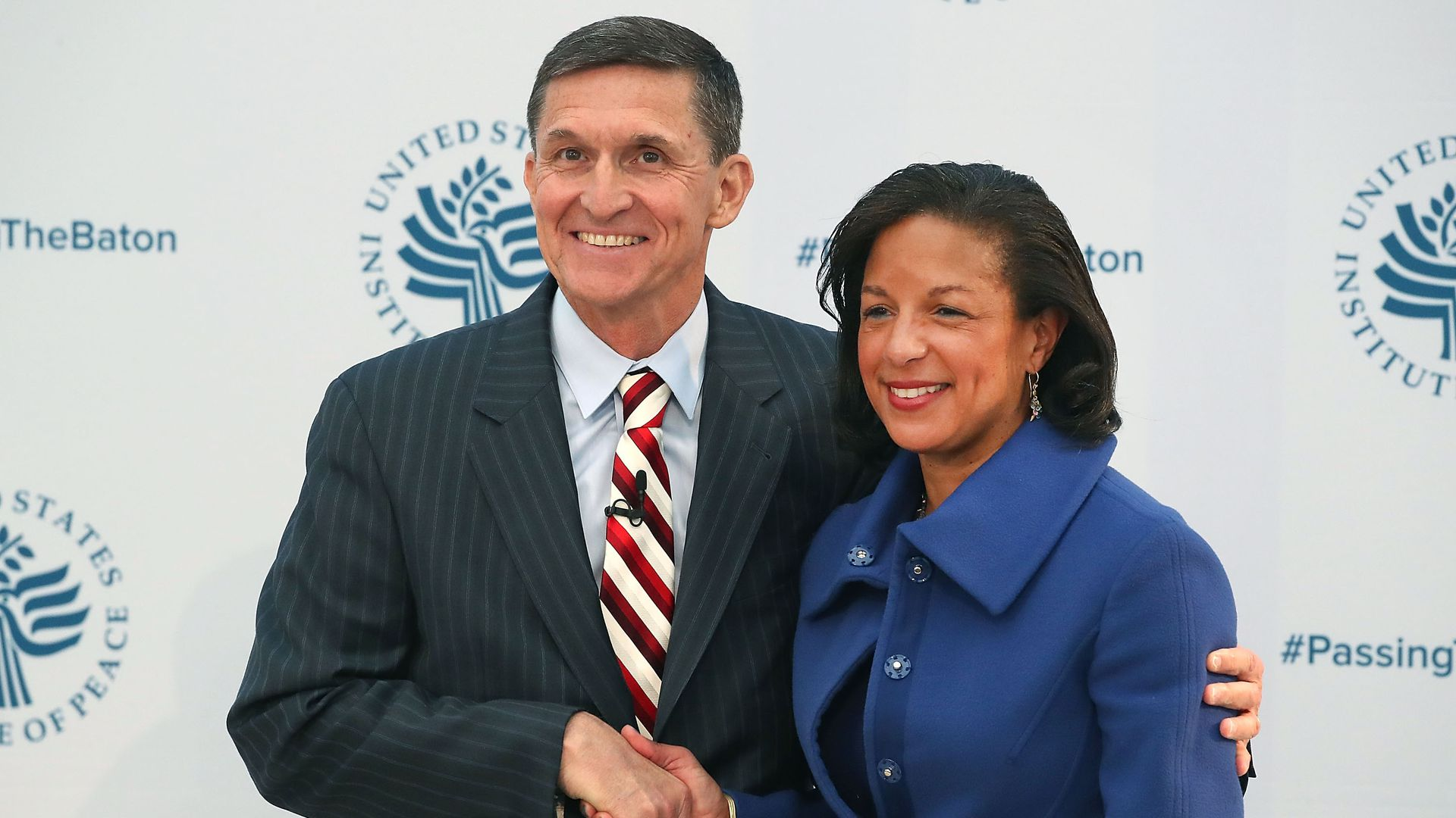 Former National Security Advisor Susan Rice poses with her replacement, Michael Flynn