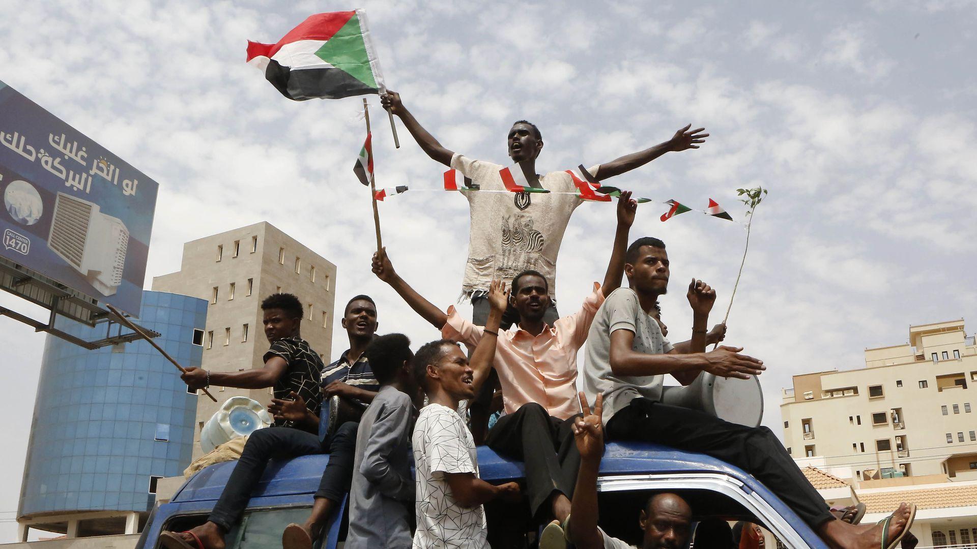 Sudanese people celebrate after civilian and military leaders reached an agreement