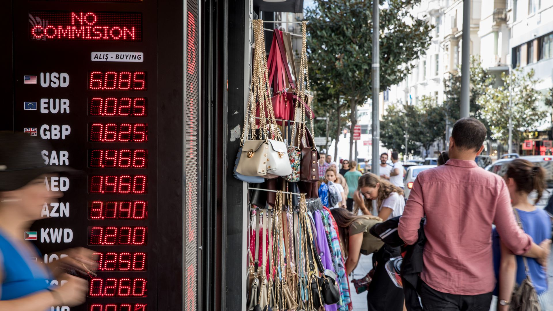 People walk past a currency exchange shop on August 14, 2018 in Istanbul, Turkey.