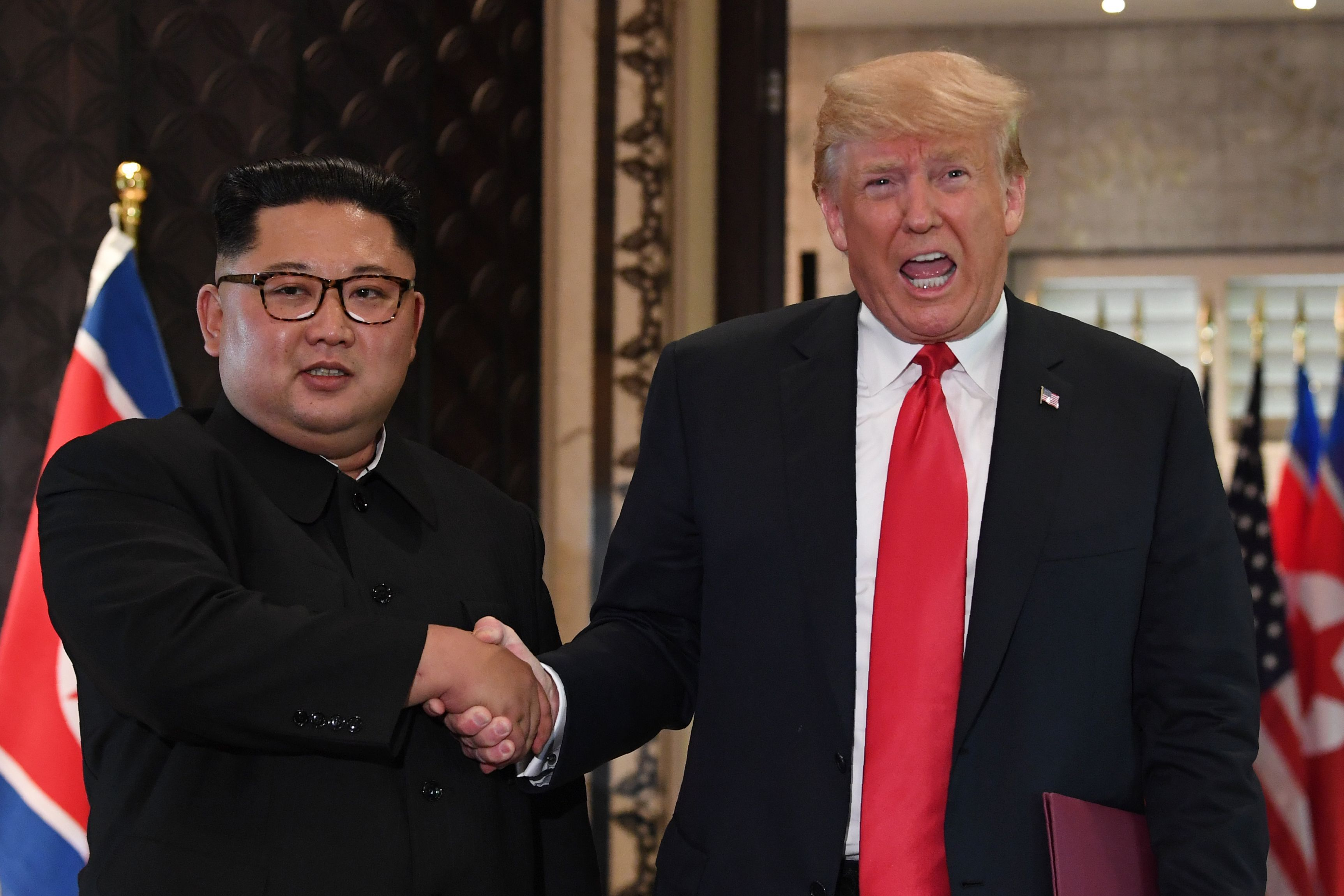 """Trump wants """"his people"""" to """"sit up at attention"""" like North Koreans - Axios"""