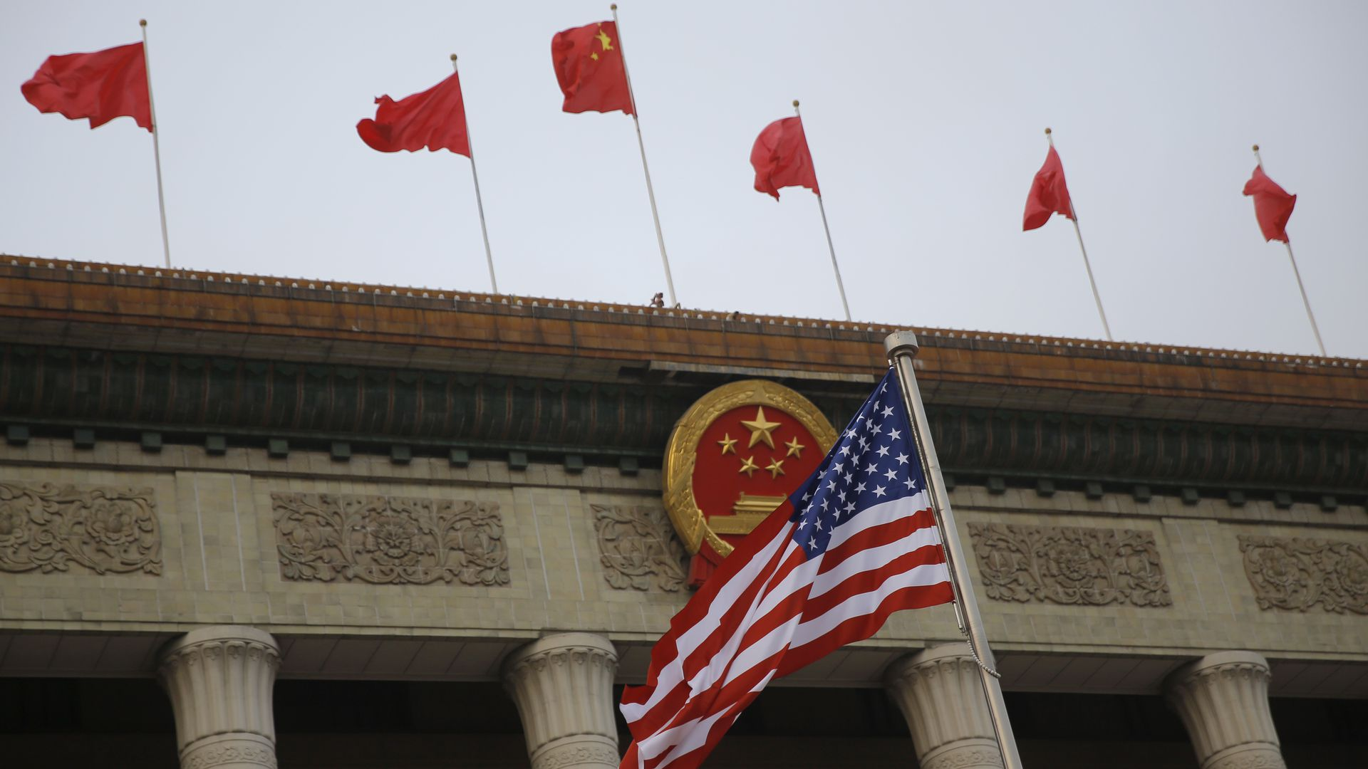 American and Chinese flags fly