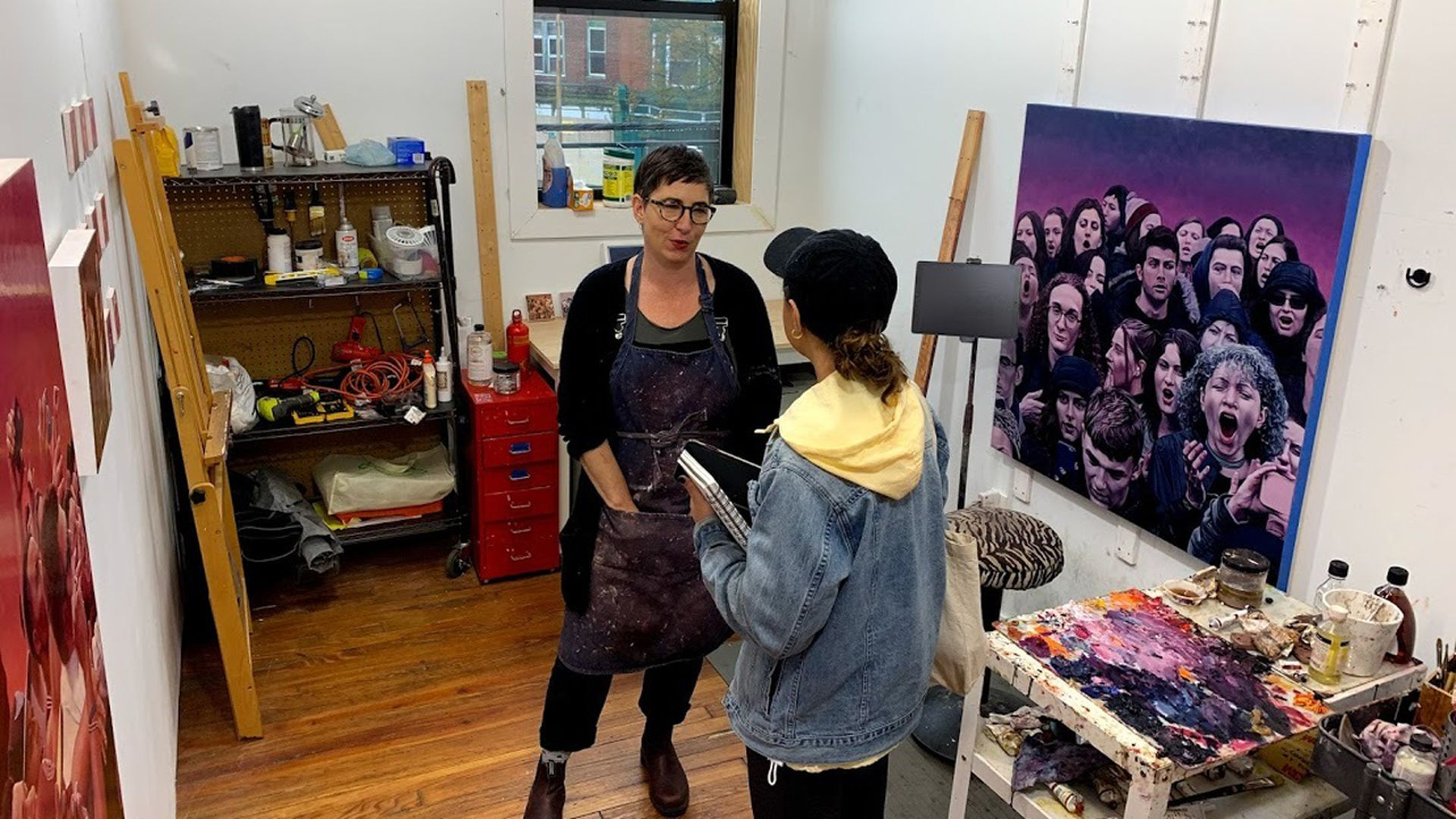 Mary Henderson, left, standing in her studio. Photo courtesy of Michael Mergen/Center for Emerging Visual Artists.