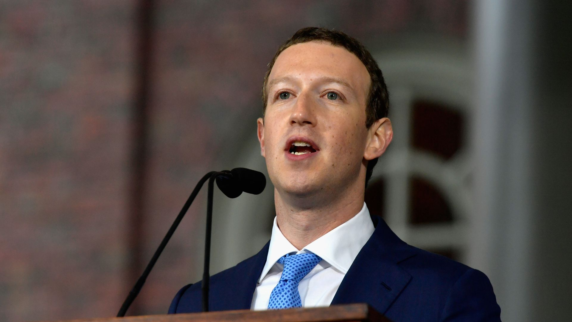 Facebook CEO Mark Zuckerberg speaks from behind a podium