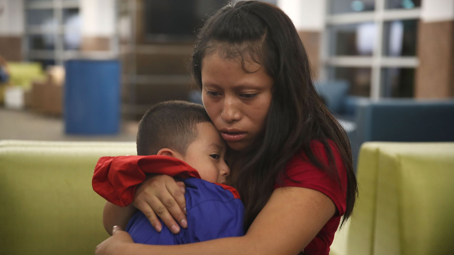 A woman, identified only as Maria, is reunited with her son, 4, at the El Paso International Airport.