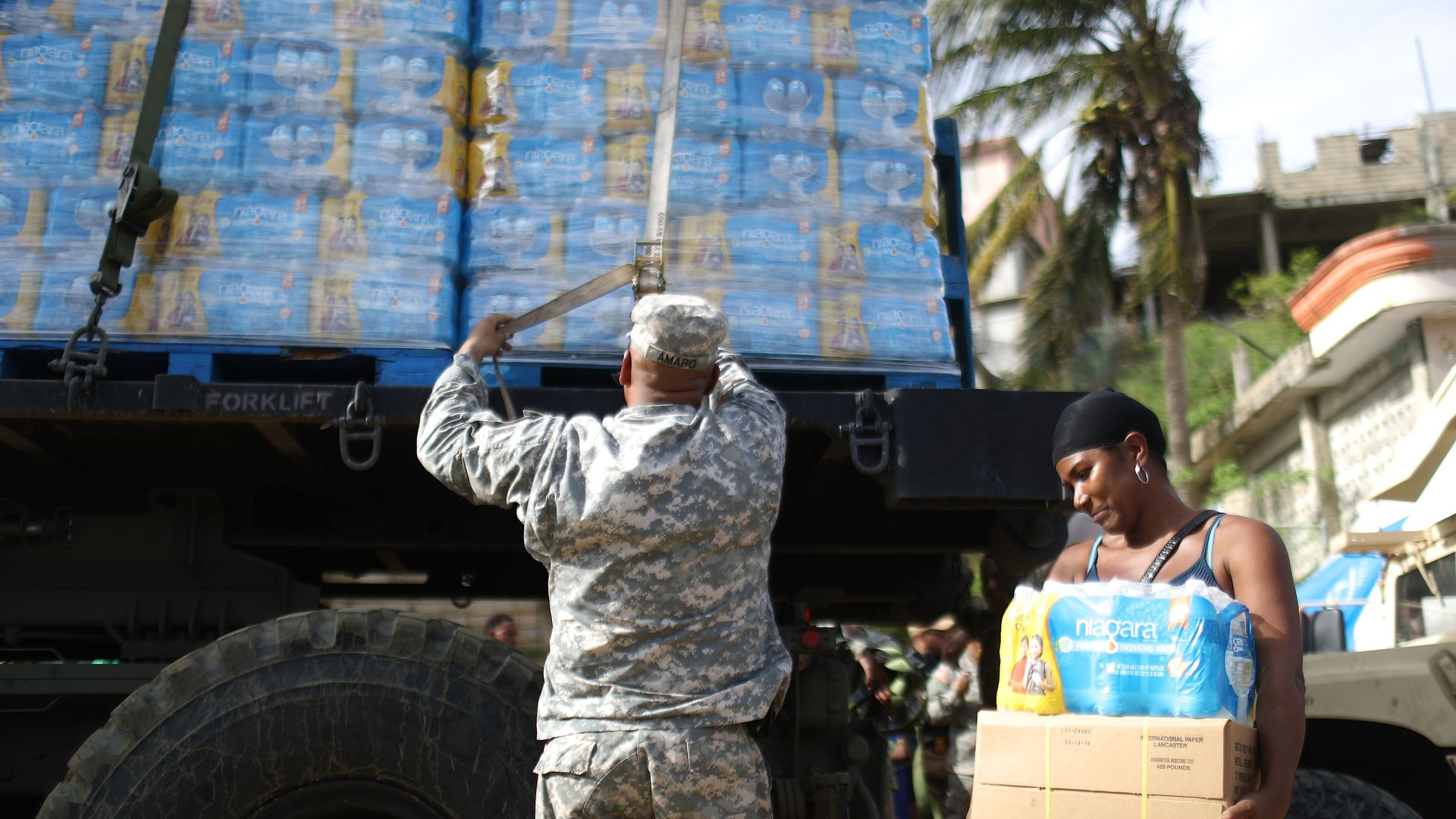 A U.S. Army soldier starts to unload a shipment of water, provided by FEMA on October 17, 2017 in San Isidro, Puerto Rico.