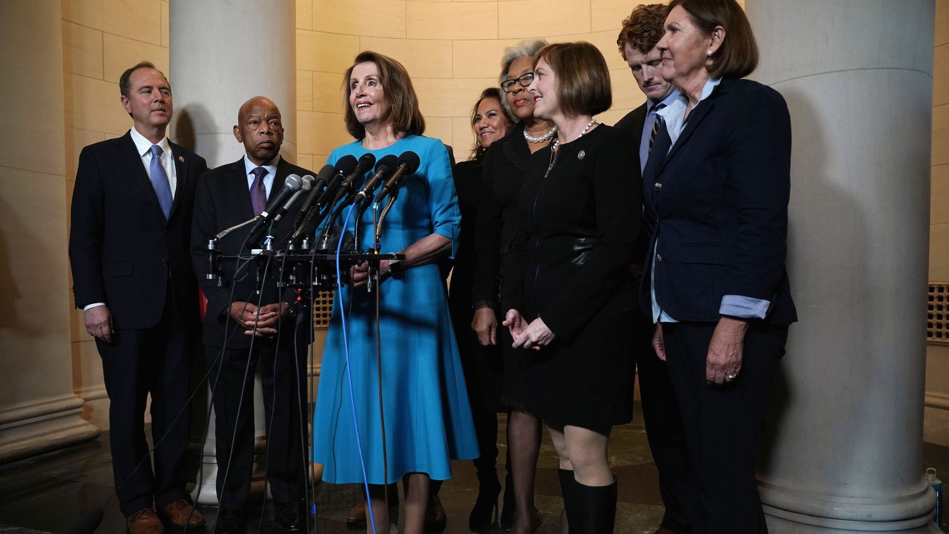 Nancy Pelosi stands with other Democrats at a press conference.