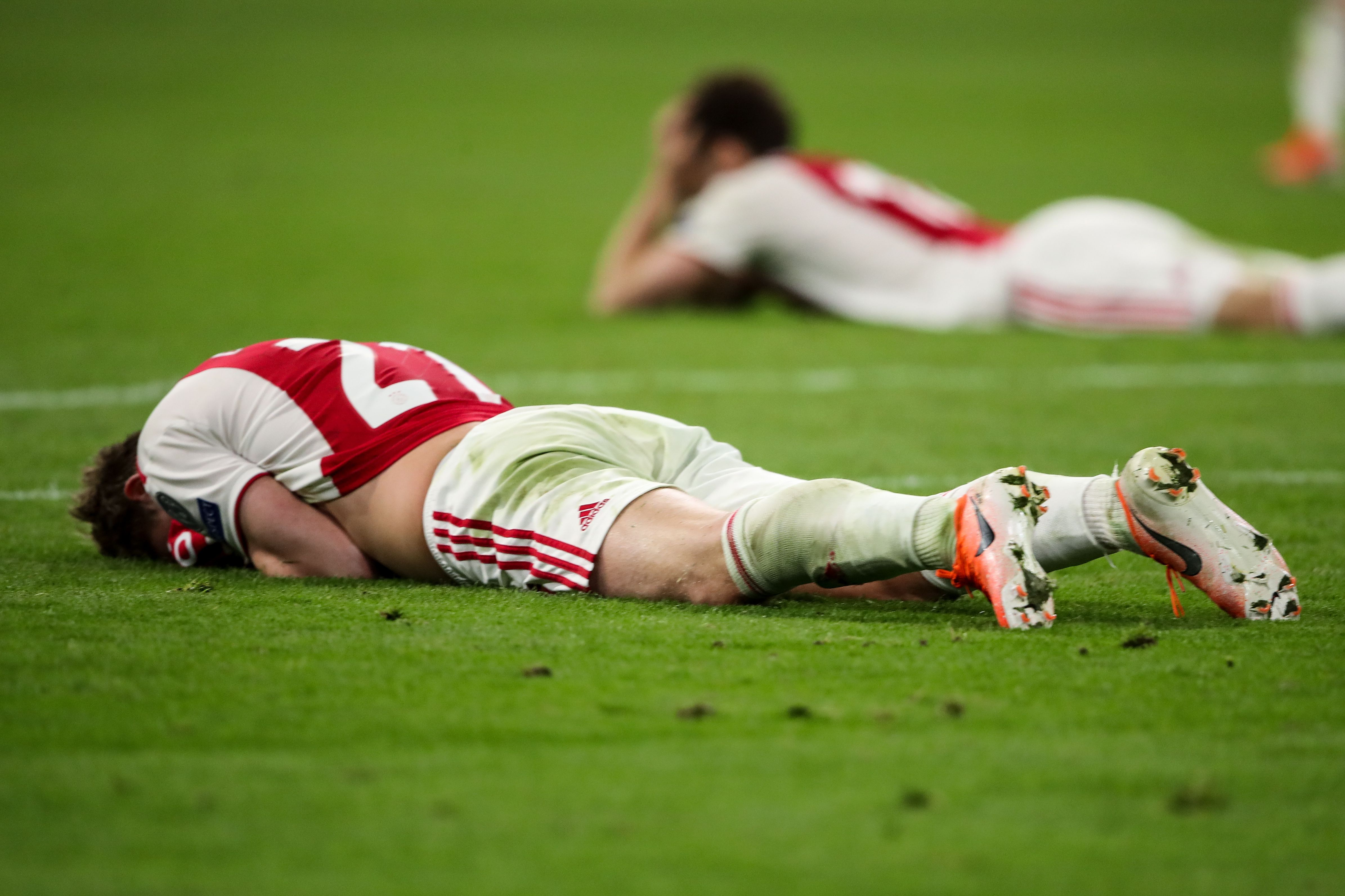 Ajax players lying on the pitch