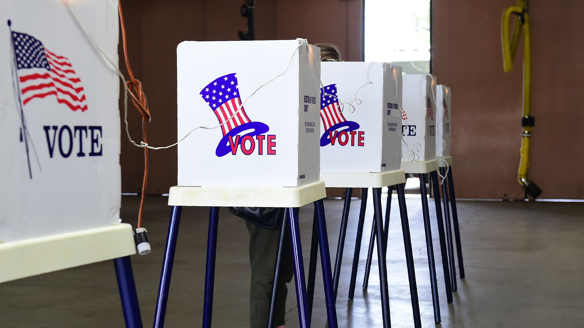 A person in a voting booth