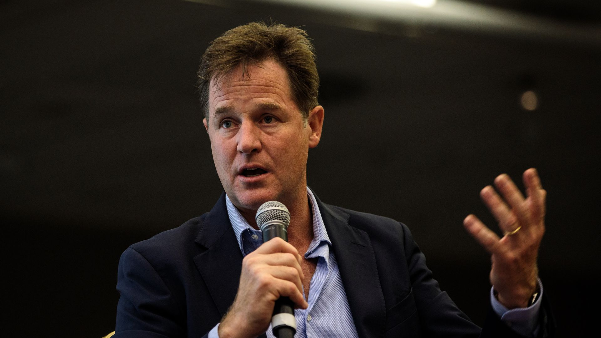 Nick Clegg speaking into a microphone.