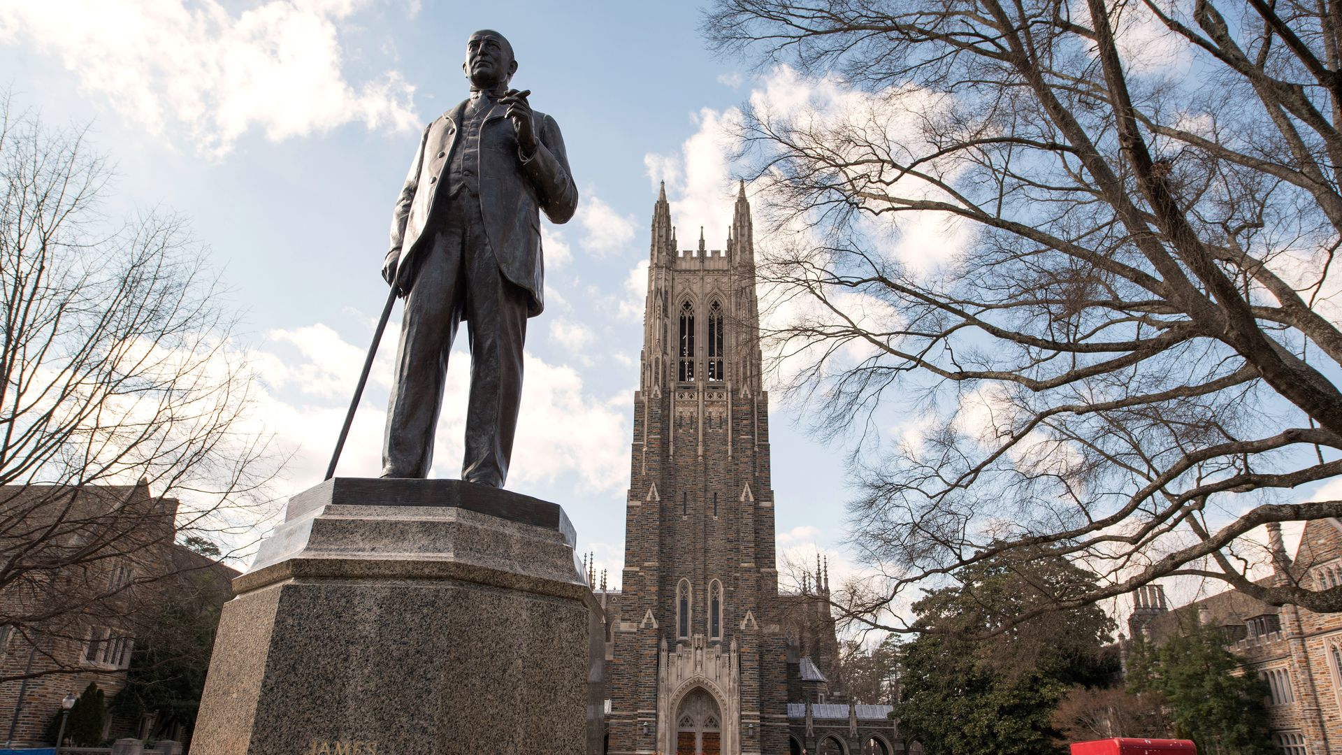 Duke statue before chapel on campus.