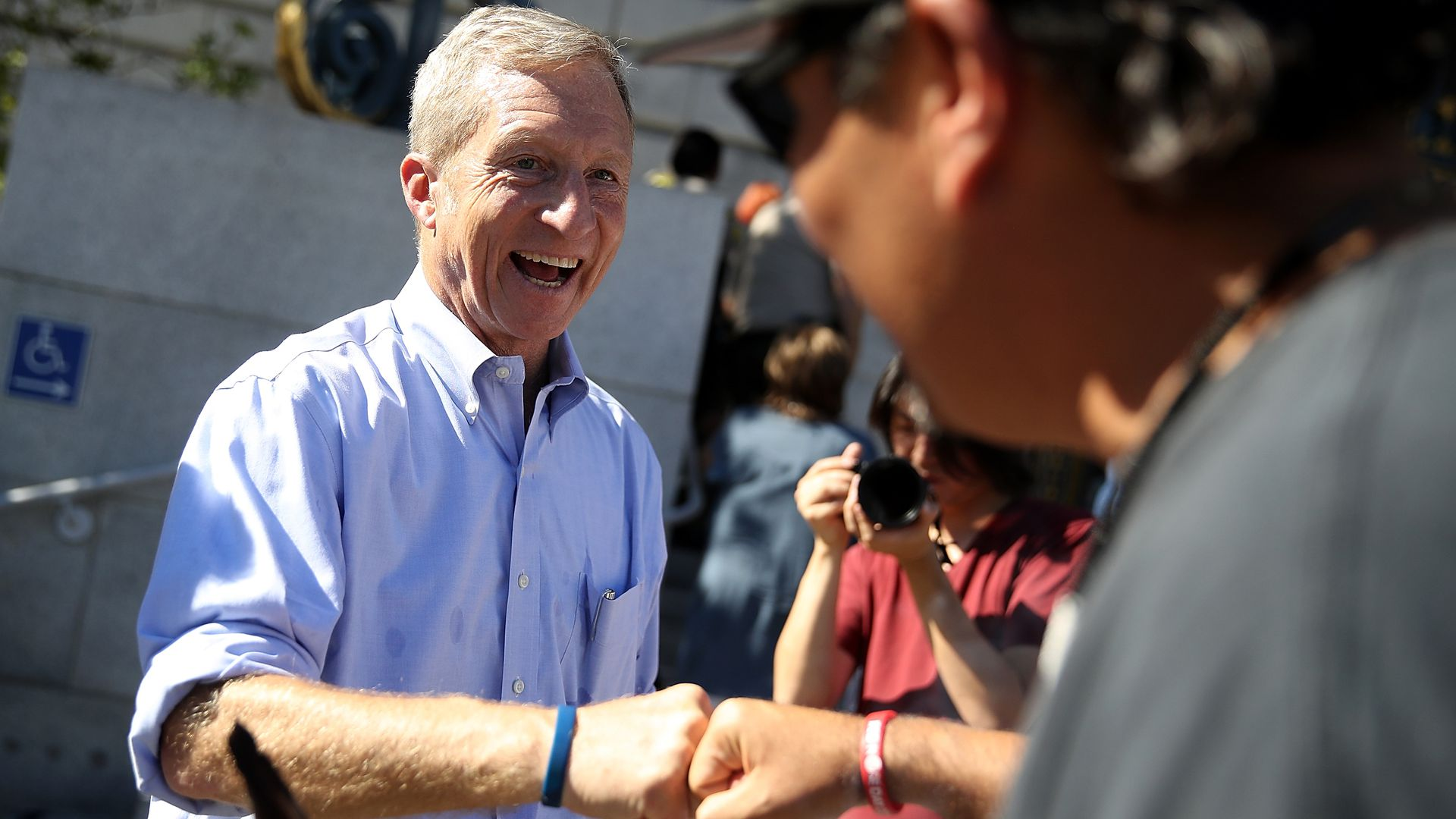 Tom Steyer talking to people at a rally