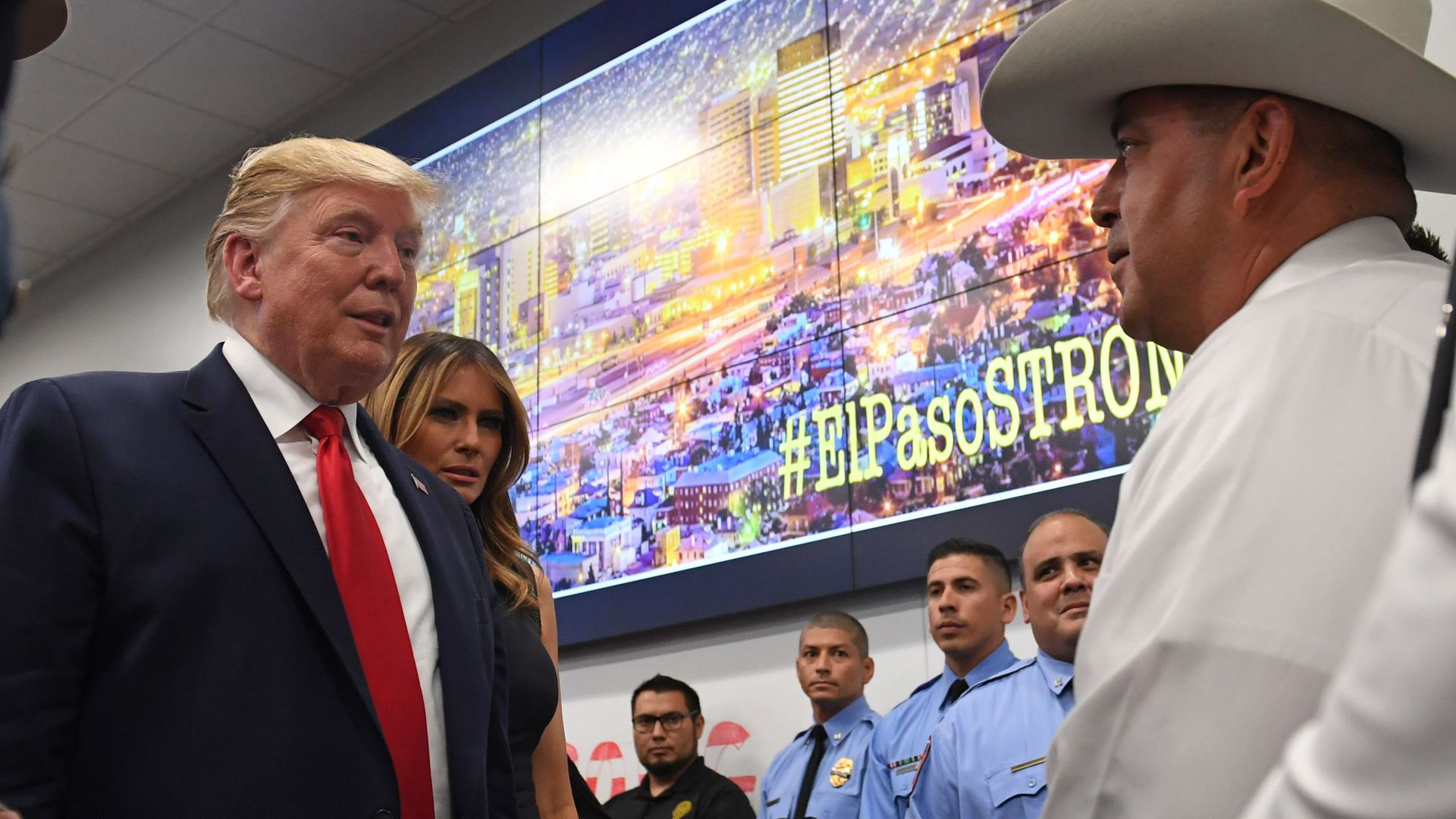 US President Donald Trump and First Lady Melania Trump greet first responders as he visits El Paso Regional Communications Center in El Paso