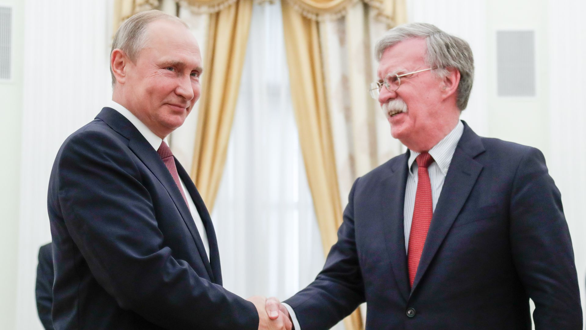 JUNE 27, 2018: Russia's President Vladimir Putin (L) and US National Security Adviser John Bolton shake hands during a meeting in the Kremlin.