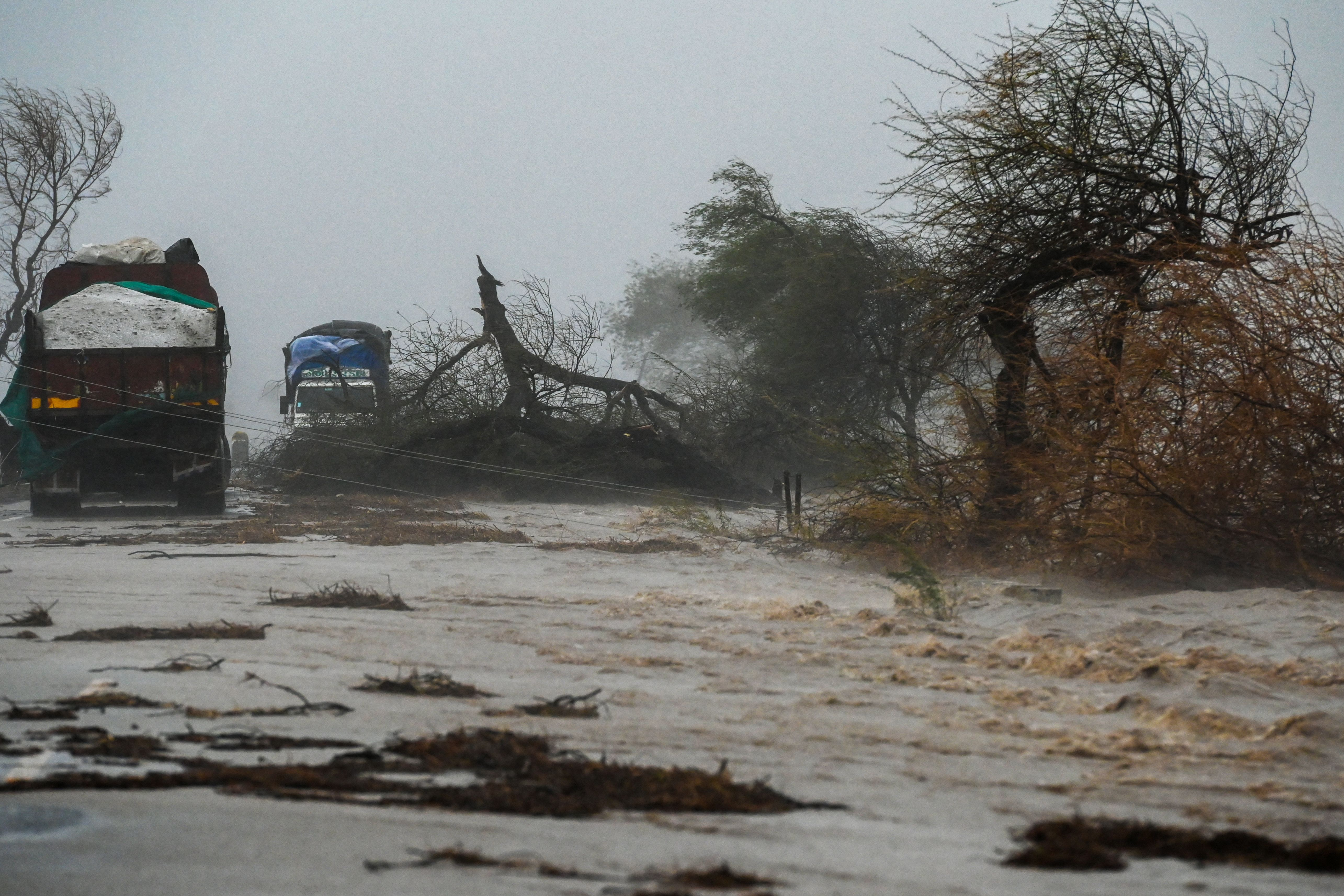Trucks are stranded on a flooded highway near Diu on May 18, 2021,