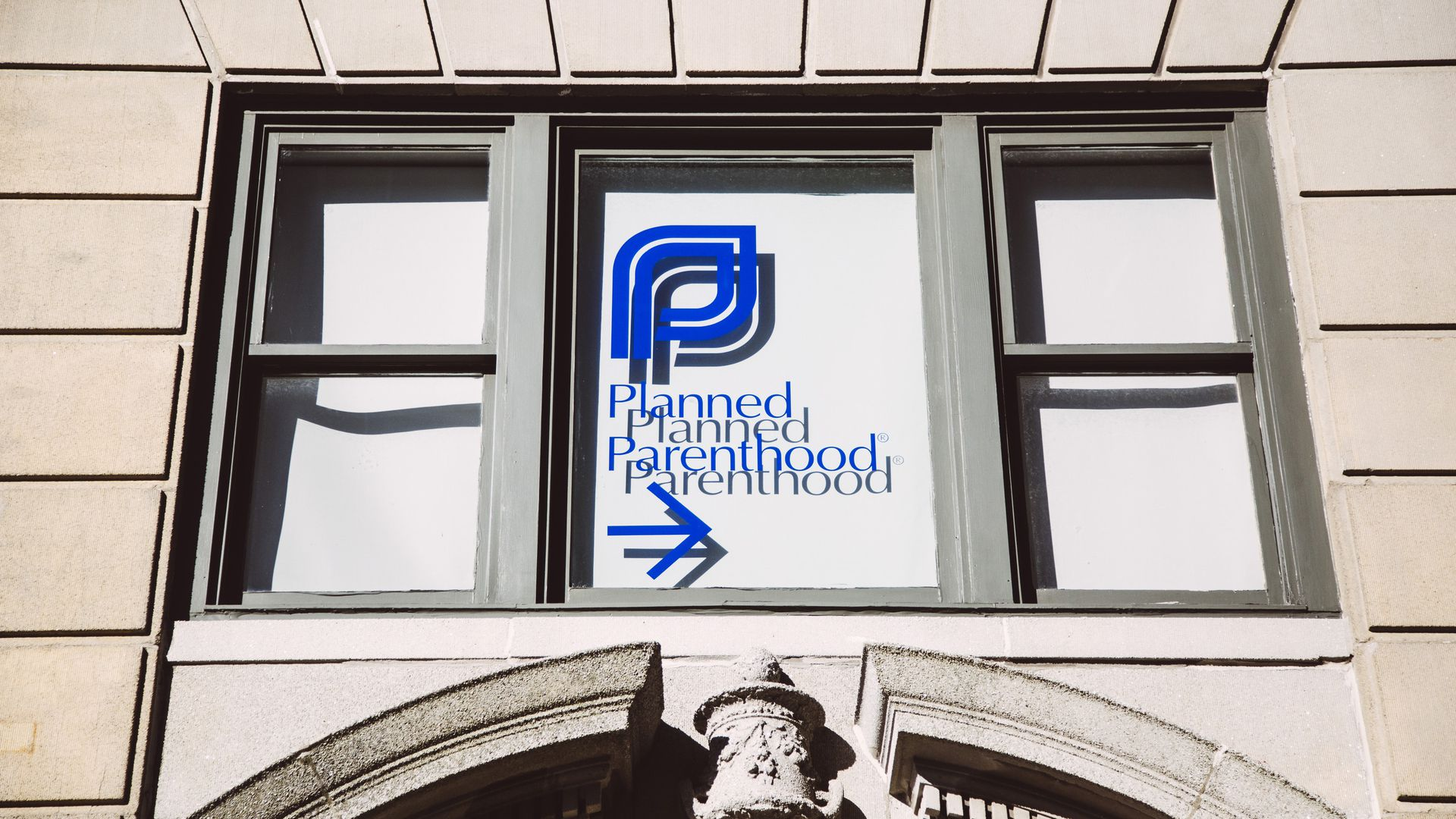In this image, the Planned Parenthood logo is seen in a window