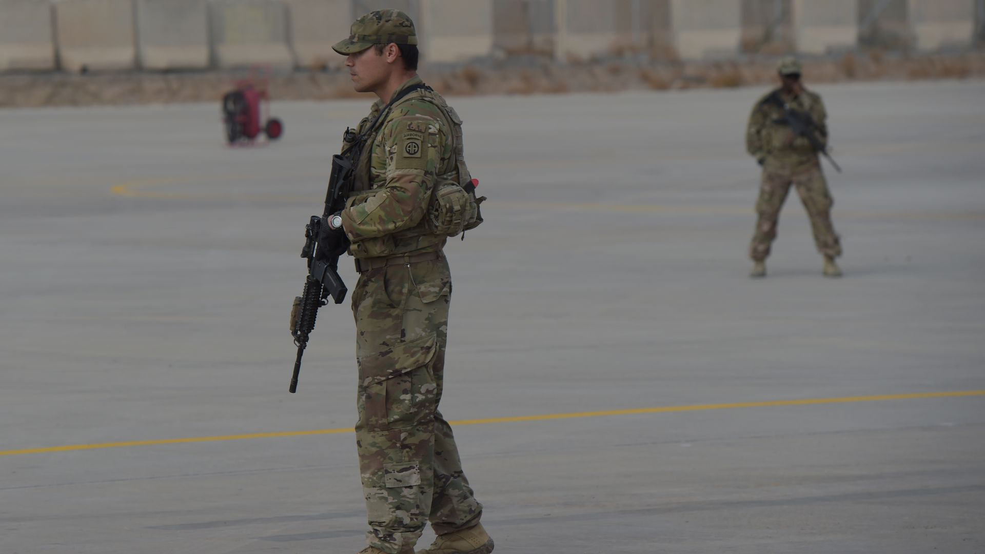 A US soldier stands guard at Kandahar Air base in Afghanistan.