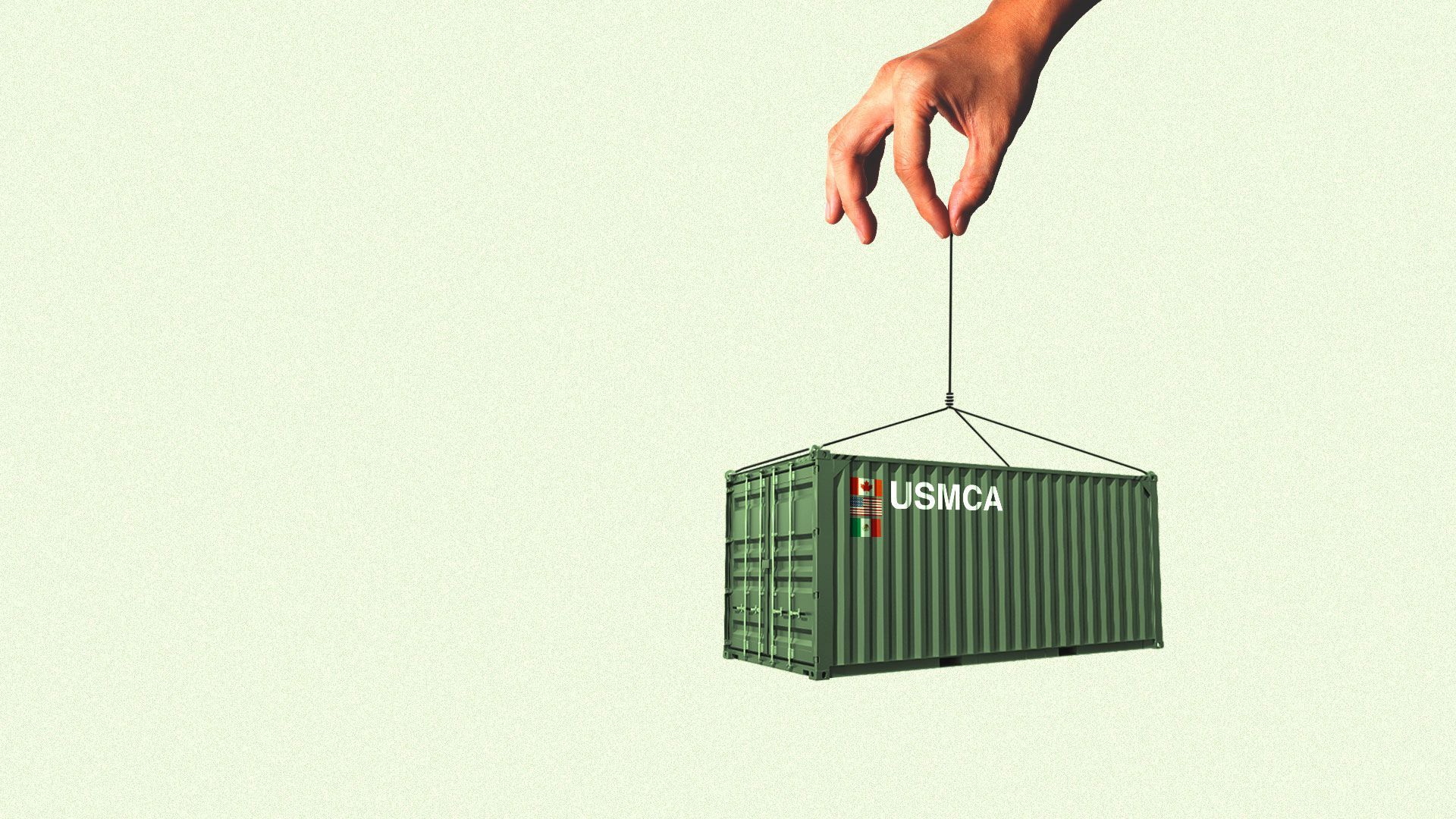 A hand holding a shipping container by a fine string