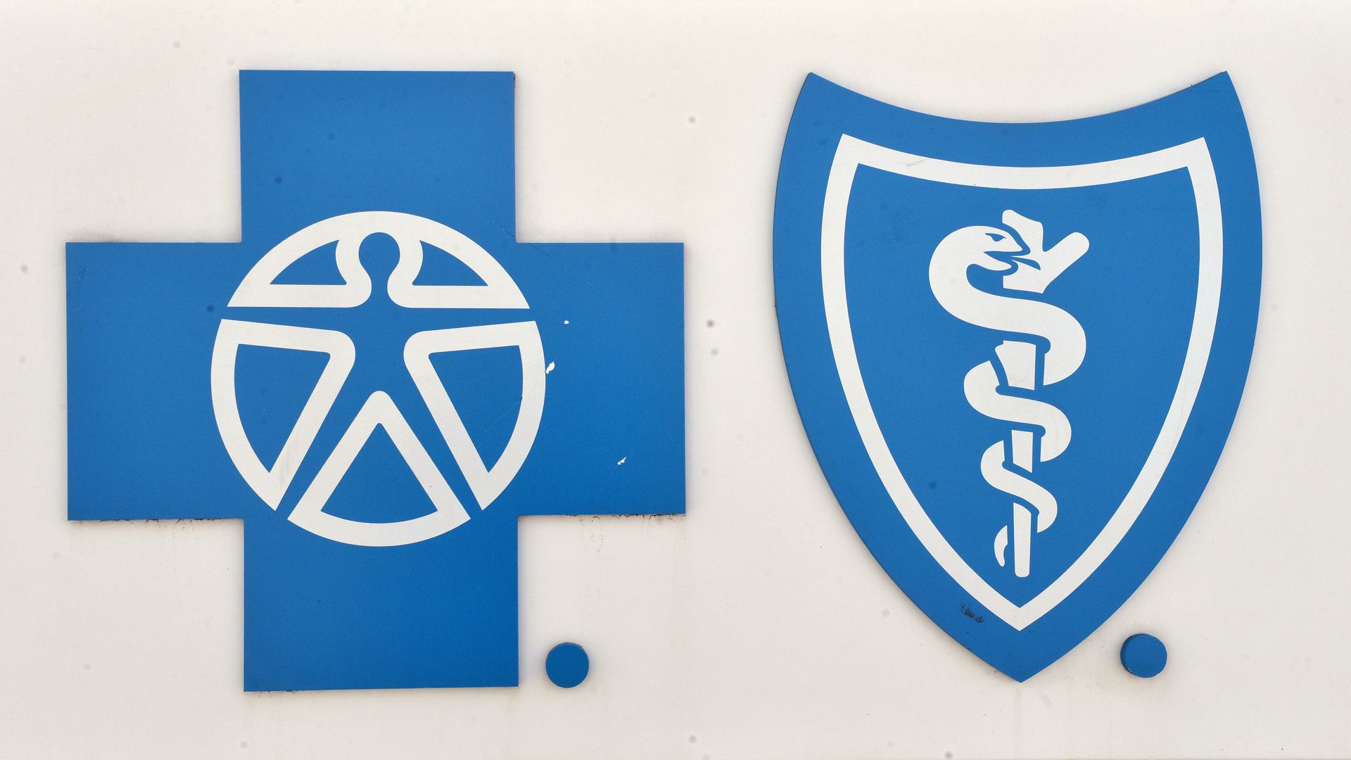 The Blue Cross and Blue Shield logo on a white sign.