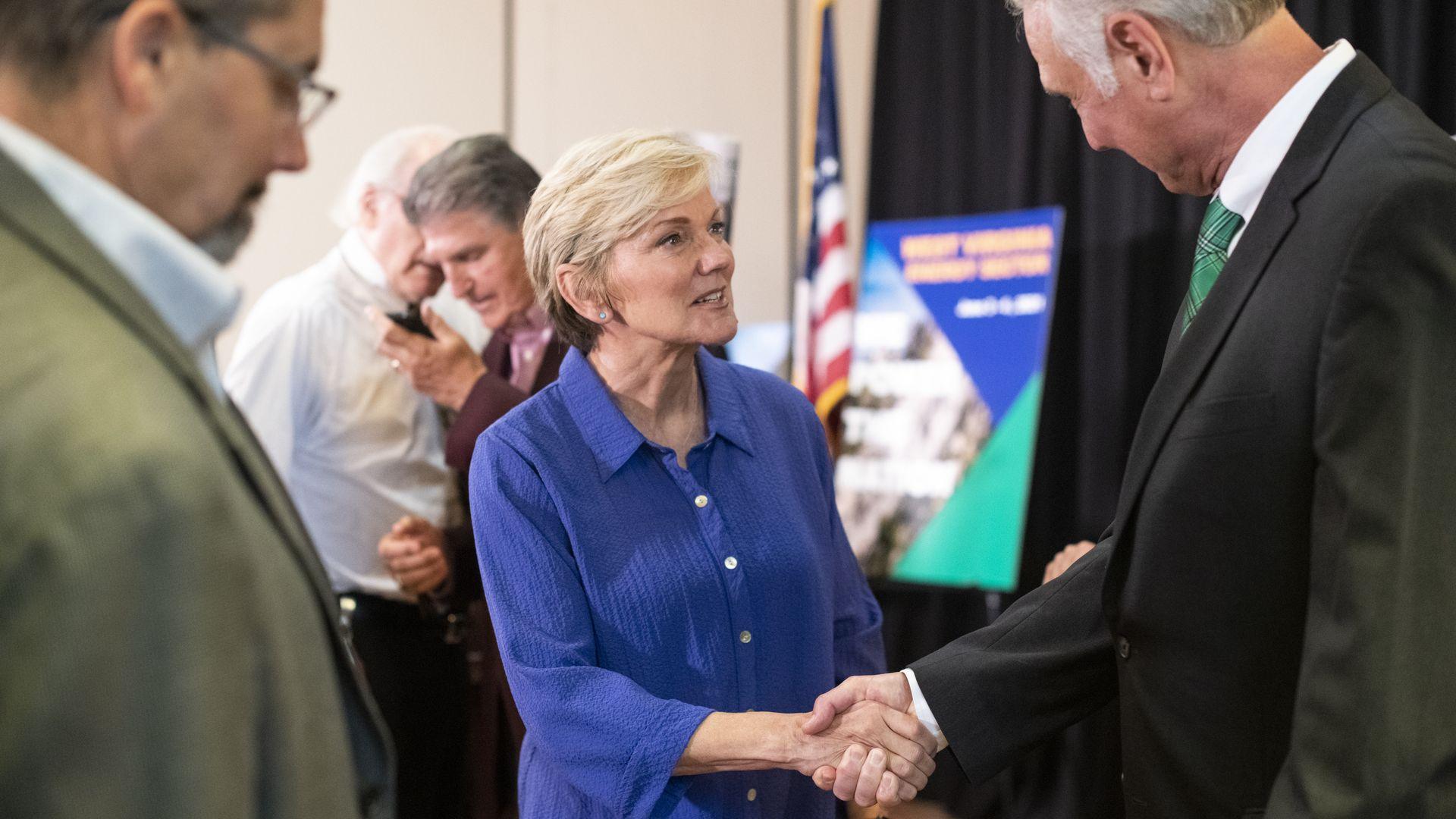 Energy Secretary Jennifer M. Granholm shakes hands at an event in West Virginia in June.