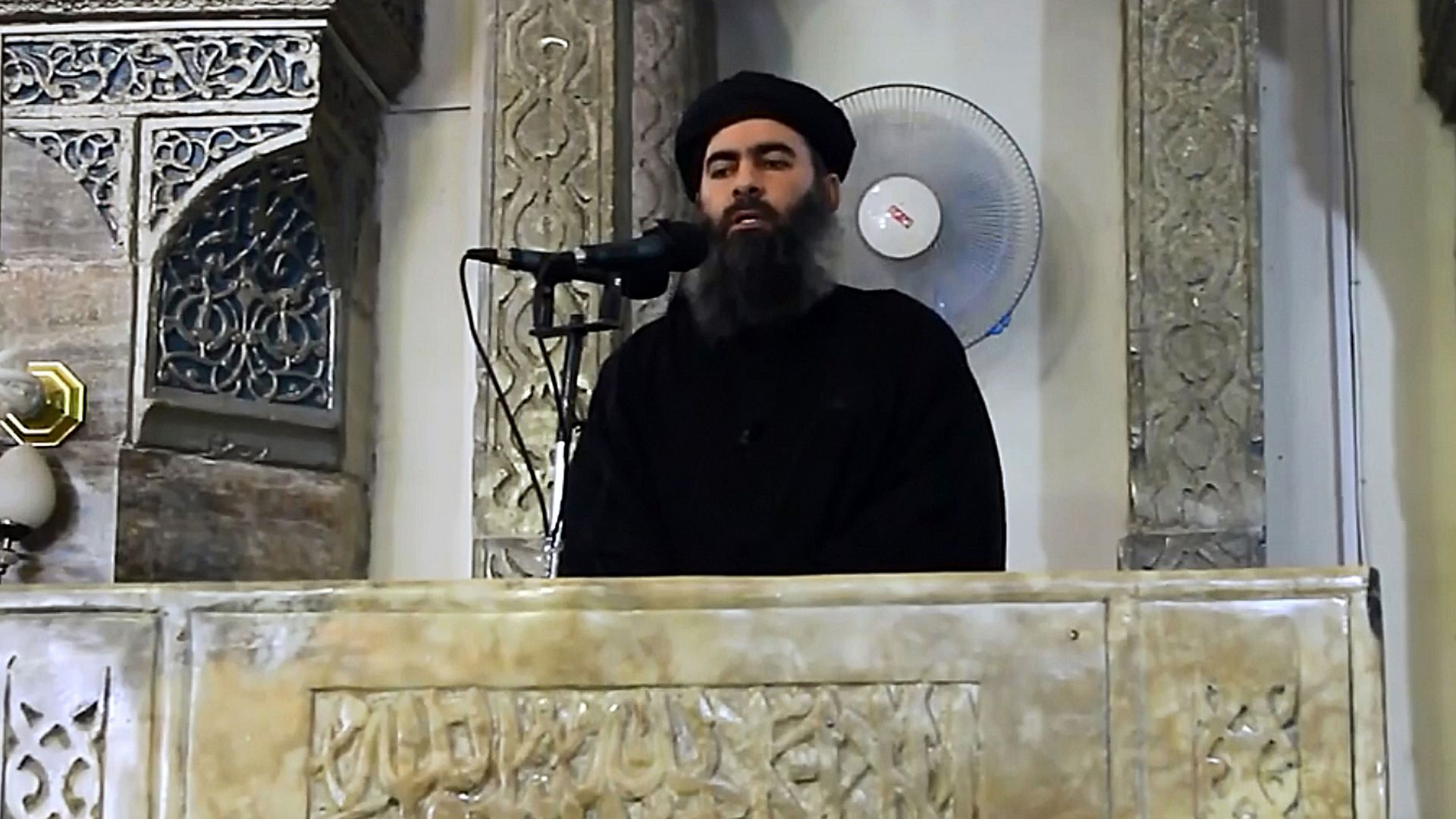 Abu Bakr al-Baghdadi in video footage speaking at a microphone.