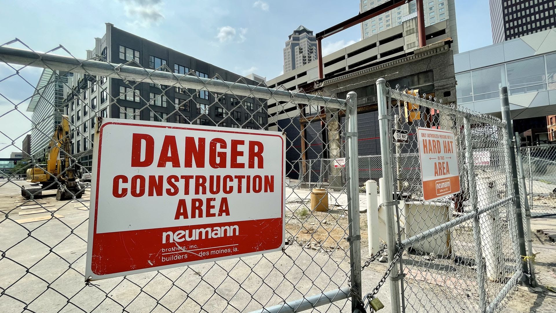 A warning sign on a fence outside the downtown Des Moines construction site where EMC Insurance wants to build a park.