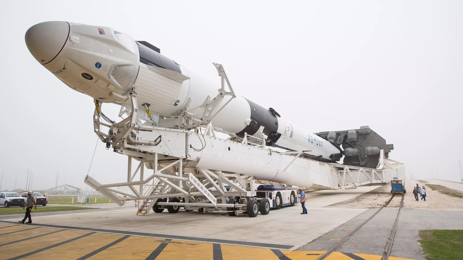 SpaceX Falcon 9 rocket with the Crew Dragon capsule makes its way to the launch pad on Feb. 28.
