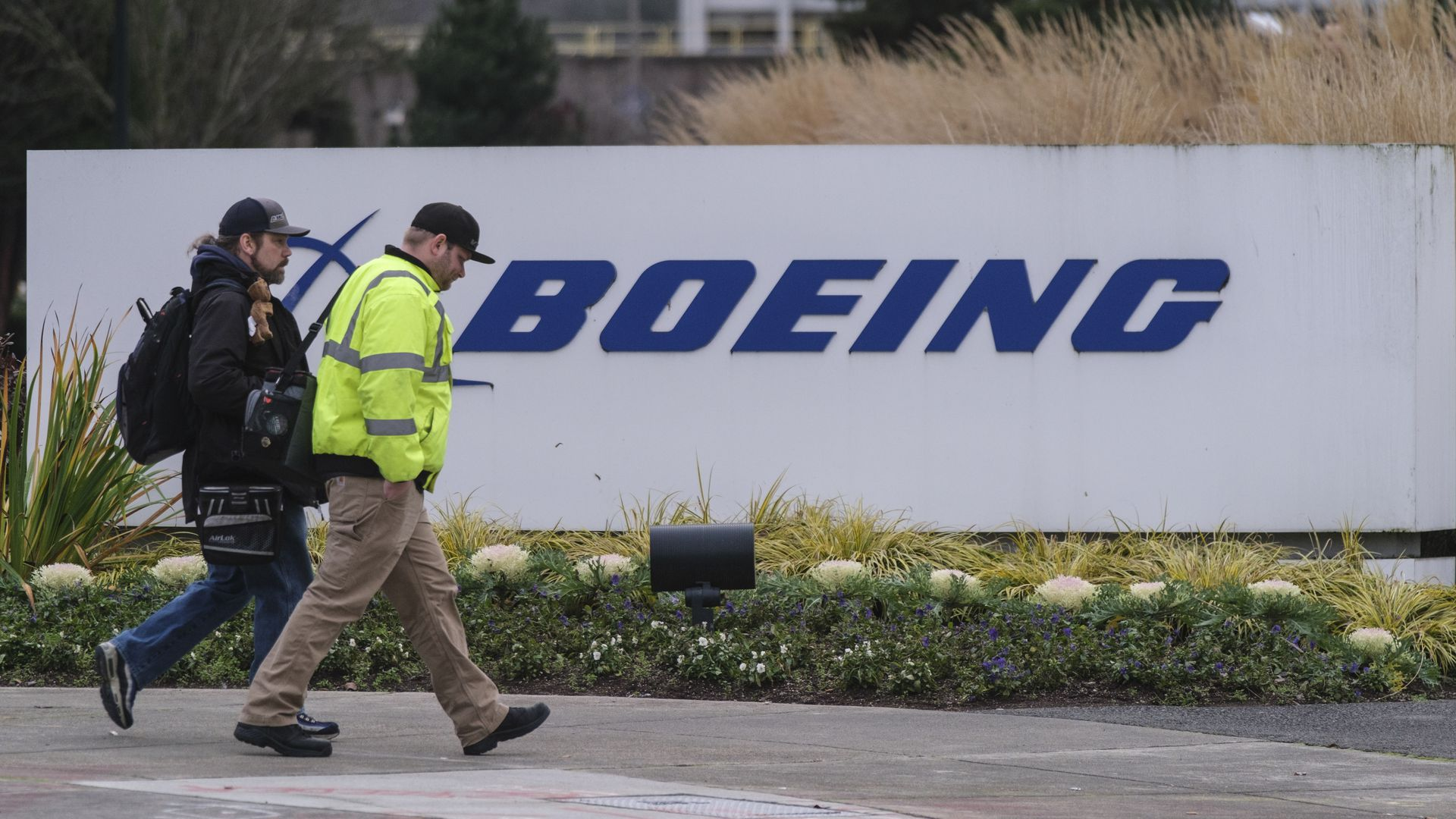 Workers walk in to the Boeing 737 factory on December 16, 2019 in Renton, Washington.