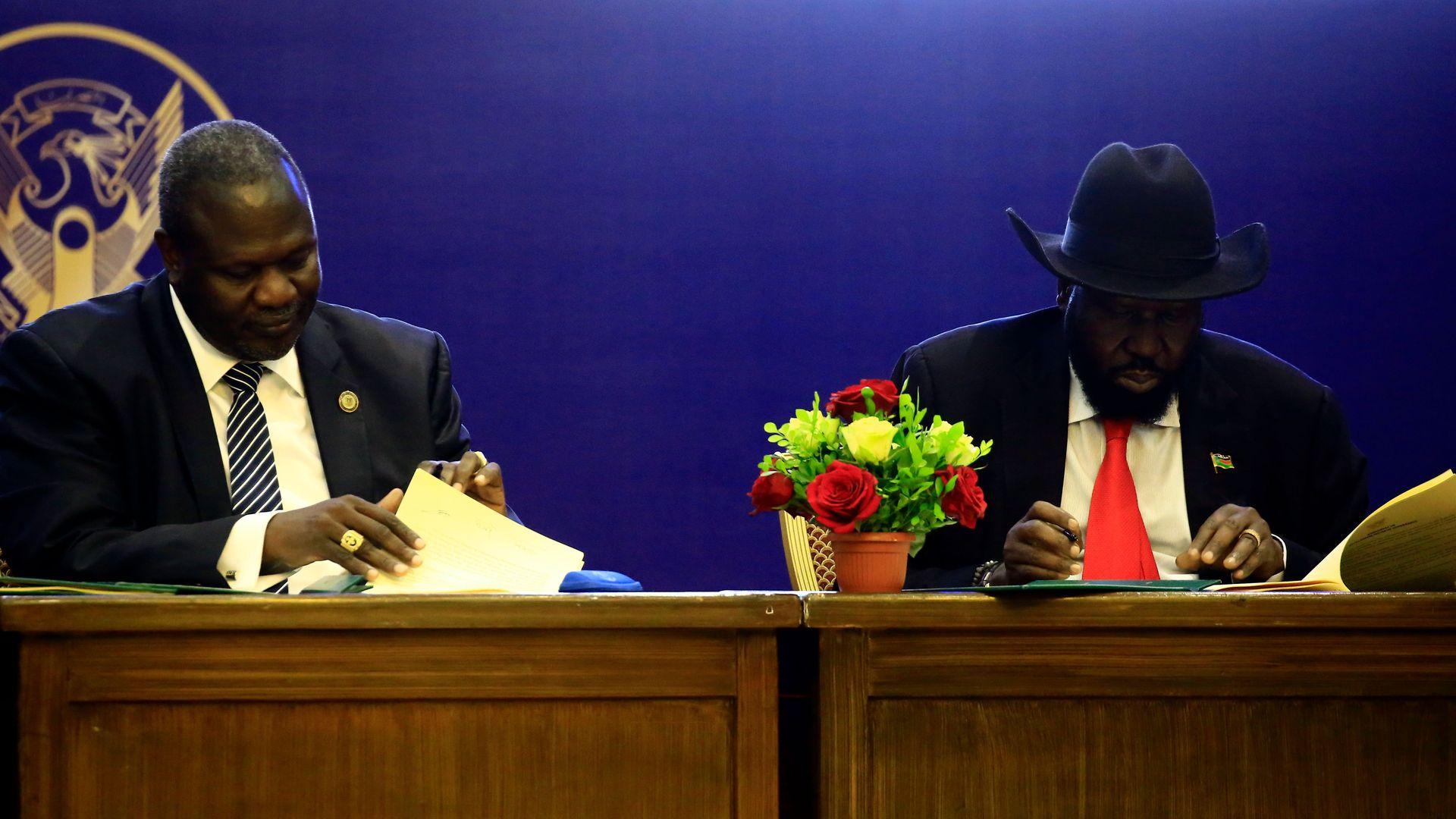 President of South Sudan, Salva Kiir (R) and South Sudan rebel leader Riek Machar attend a final power-sharing deal between South Sudanese arch-foes.