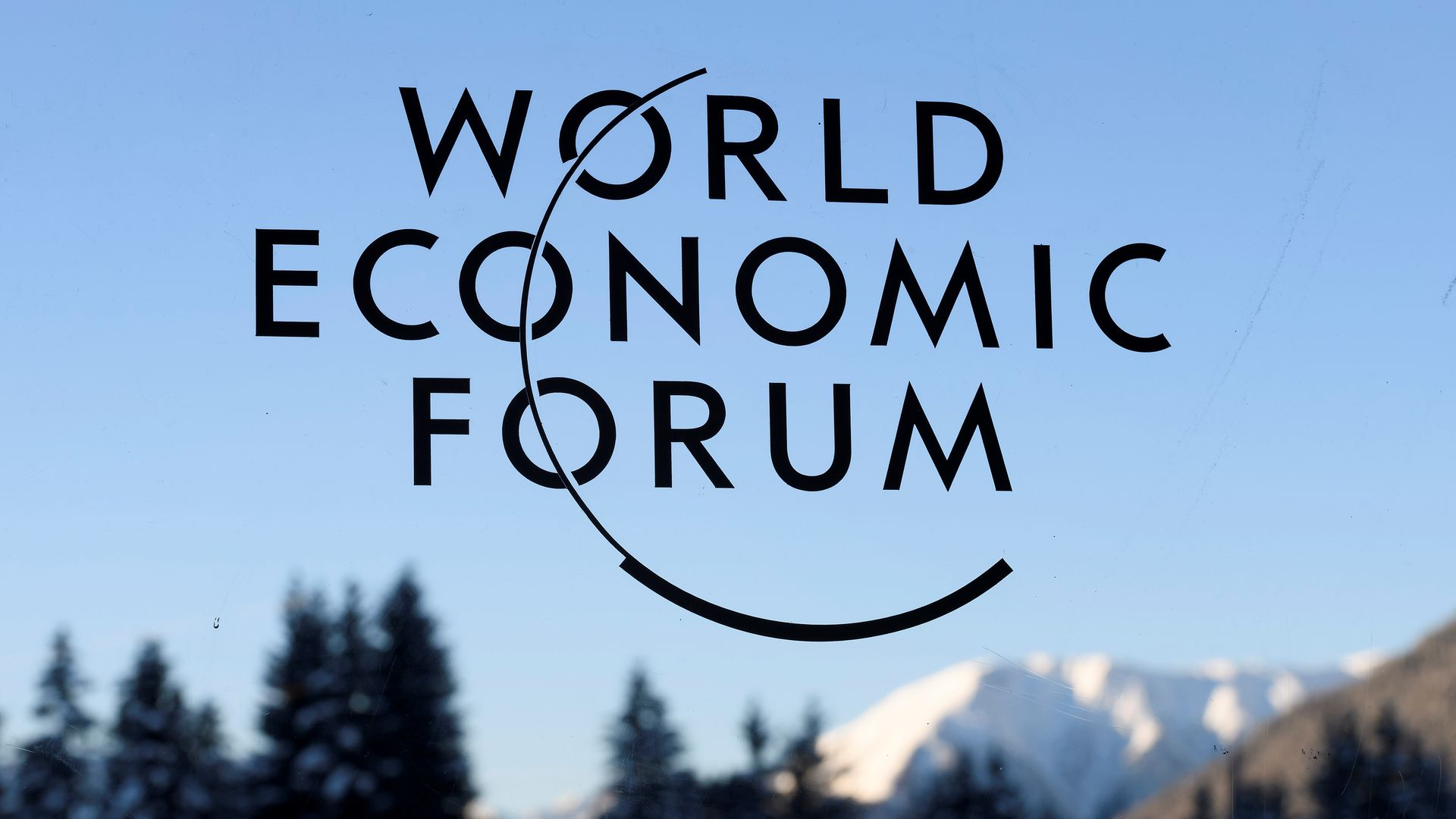 A sign and logo of the World Economic Forum in Davos