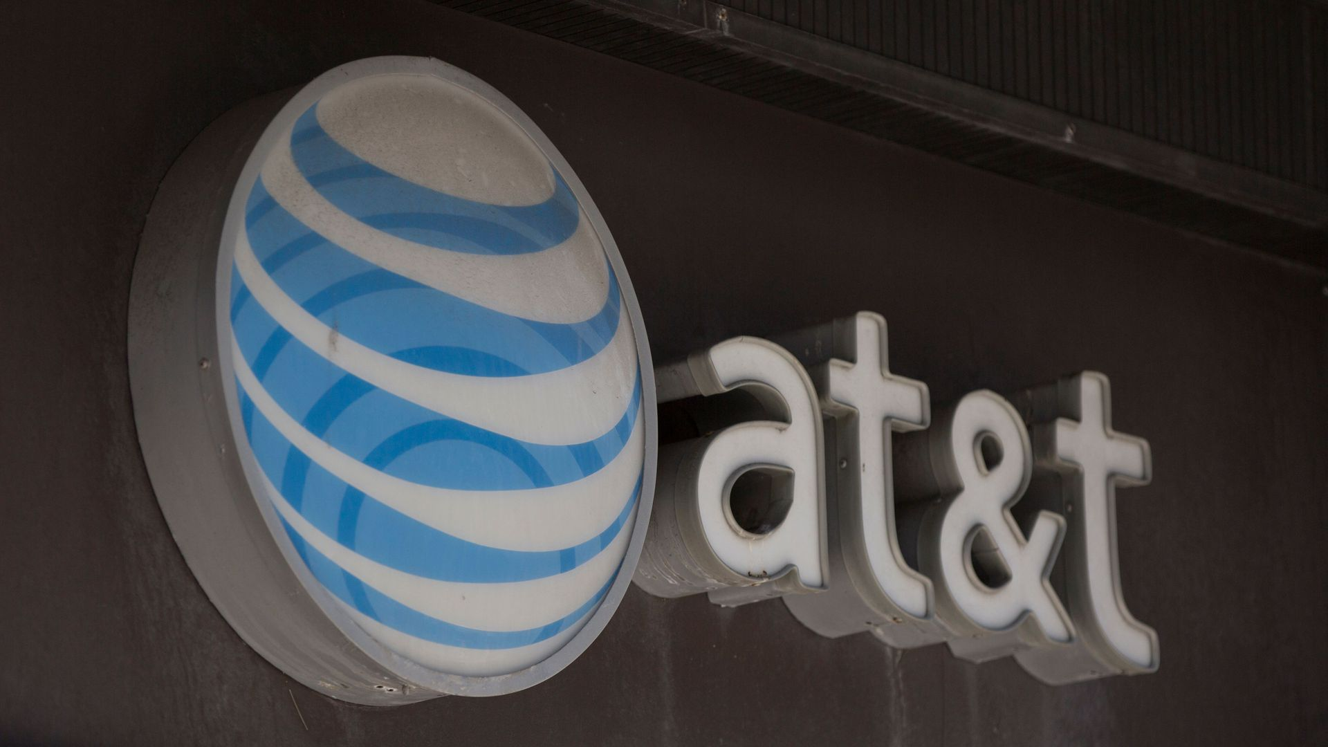 A photo of AT&T's logo and next to the company's name.