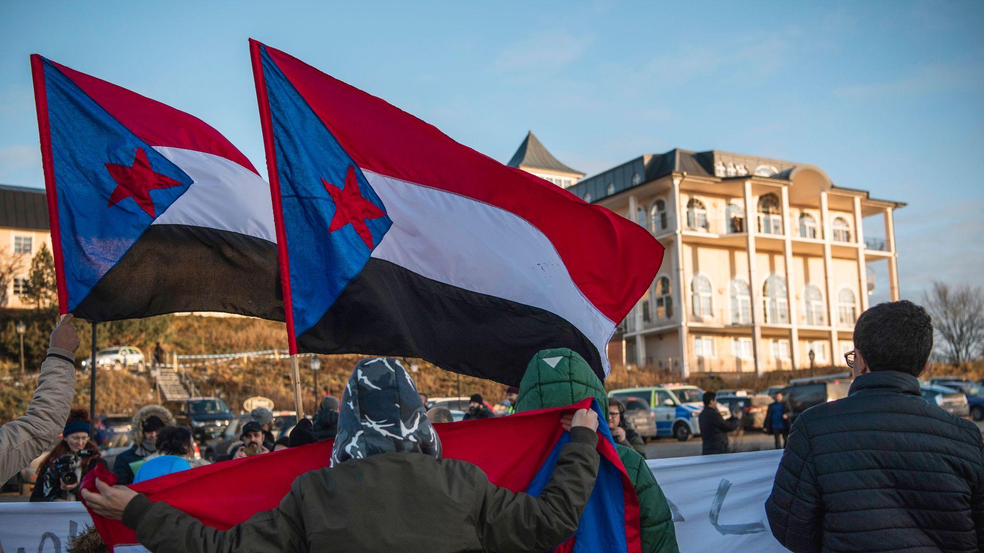Protestors wave south Yemen flag outside Sweden meeting