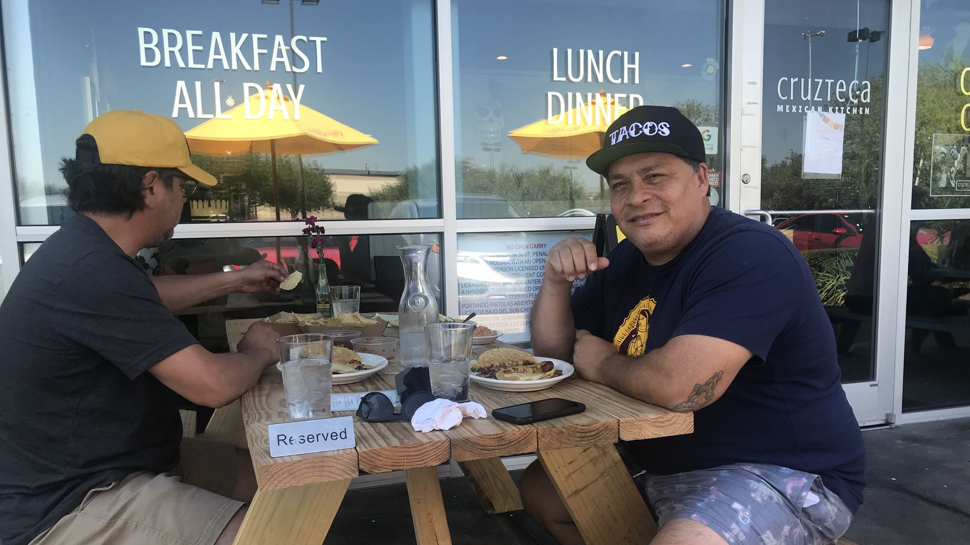 Mando Rayo, right, digs into some grub at Cruzteca