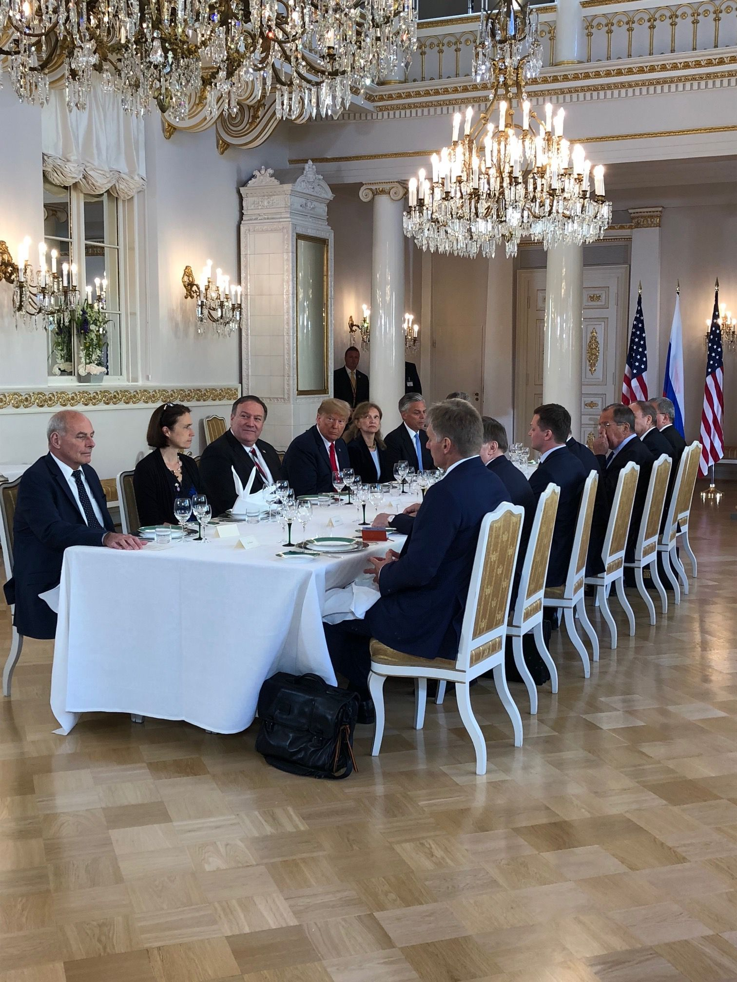President Trump and President Putin at a dining table with other officials.